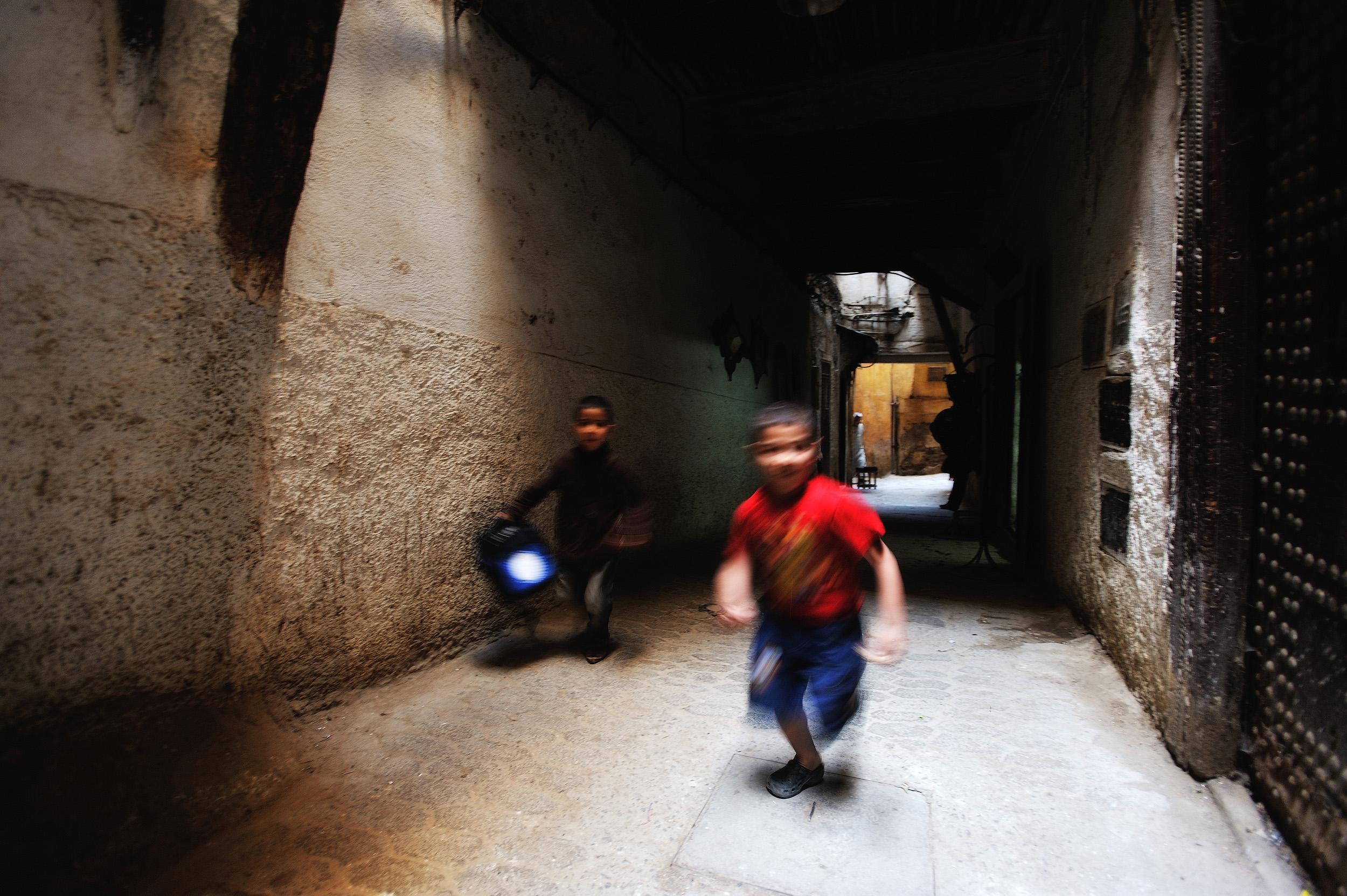 Fes   Two boys run through Fes Medina.