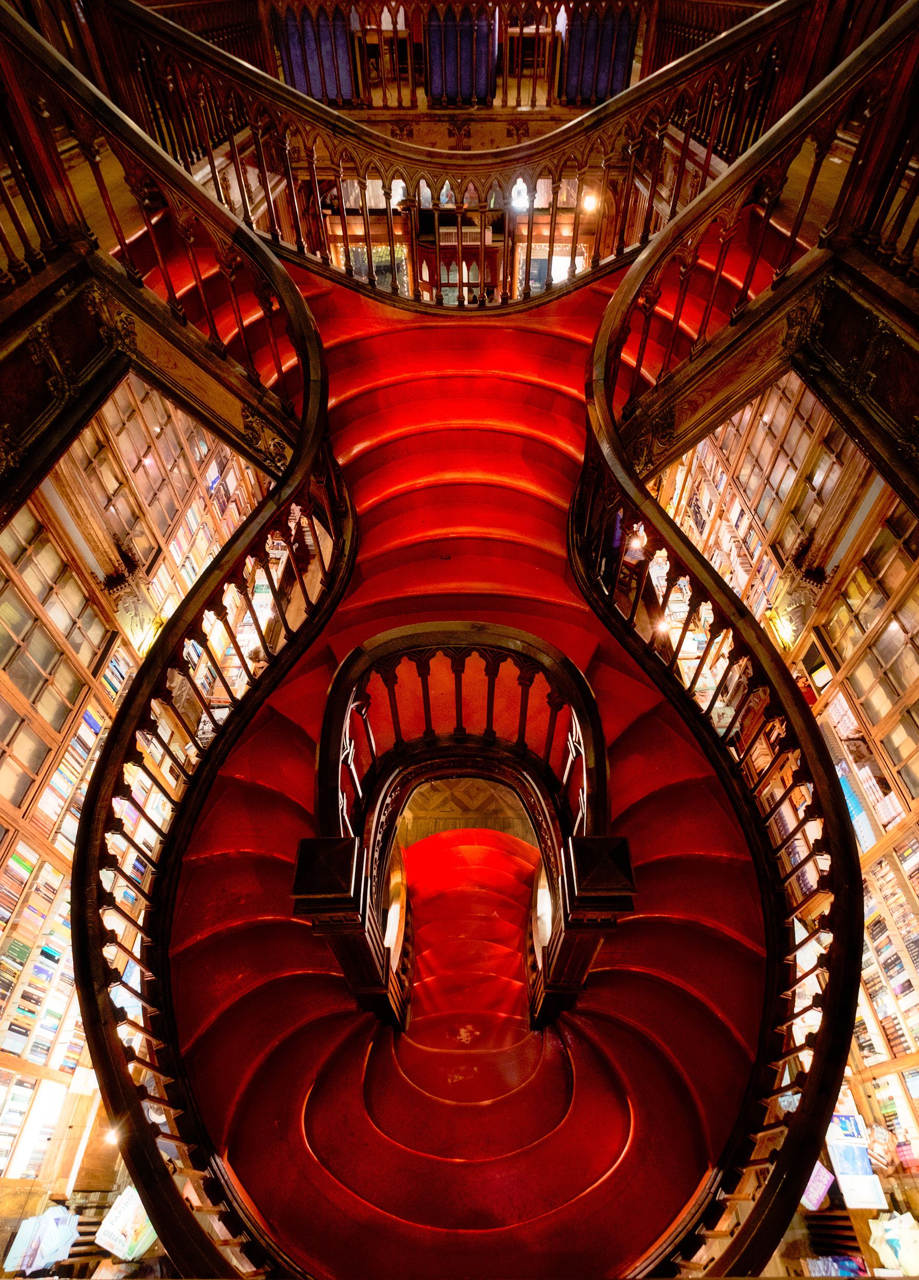 Lello & Irmão   Lello bookshop in Porto was voted one of the most beautiful bookshops in the world. It's a tiny place with beautifully carved ceilings and shelves and this amazingly graceful gothic staircase, which really is a wonder of design and craftsmanship.