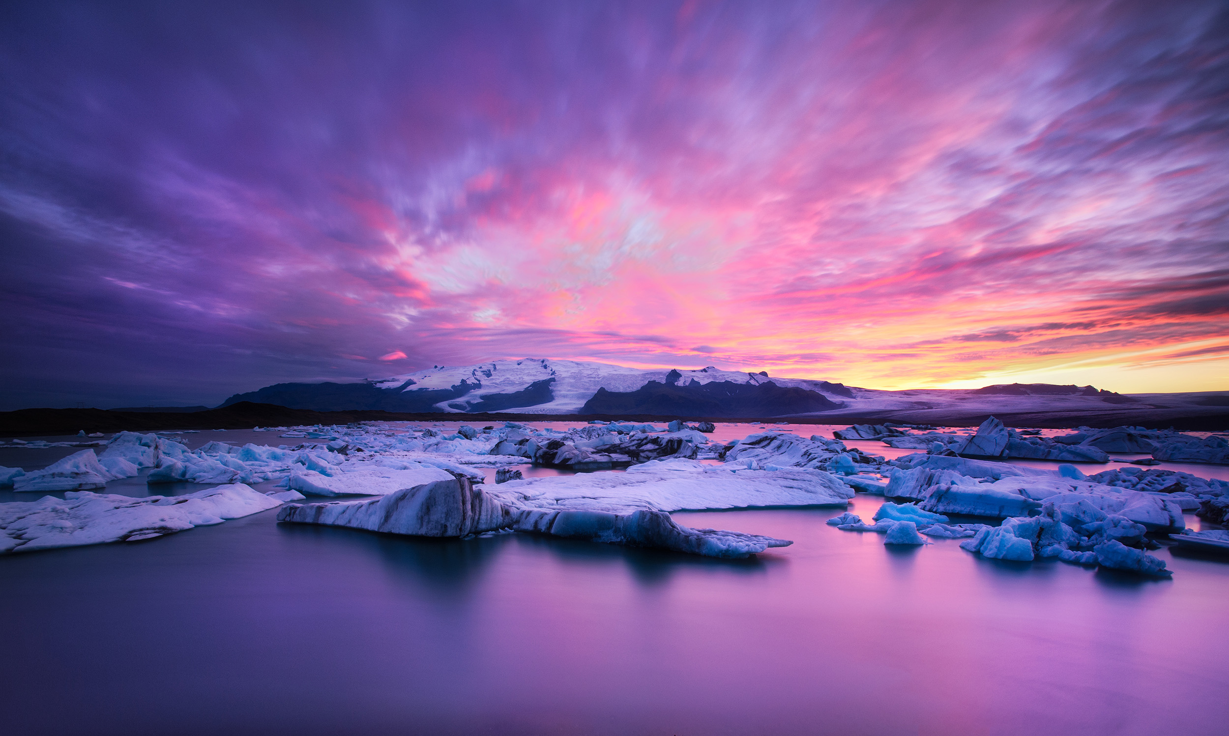 Jokulsarlon  Sunset at the lagoon of Jokulsarlon. The huge Vatnajökull glacier (the biggest icecap outside of the two poles) is in the background and a branch of it comes down the valley to the lagoon where icebergs calve off, float across the lagoon, and then eventually out to sea. The ice here is 1000 years old apparently