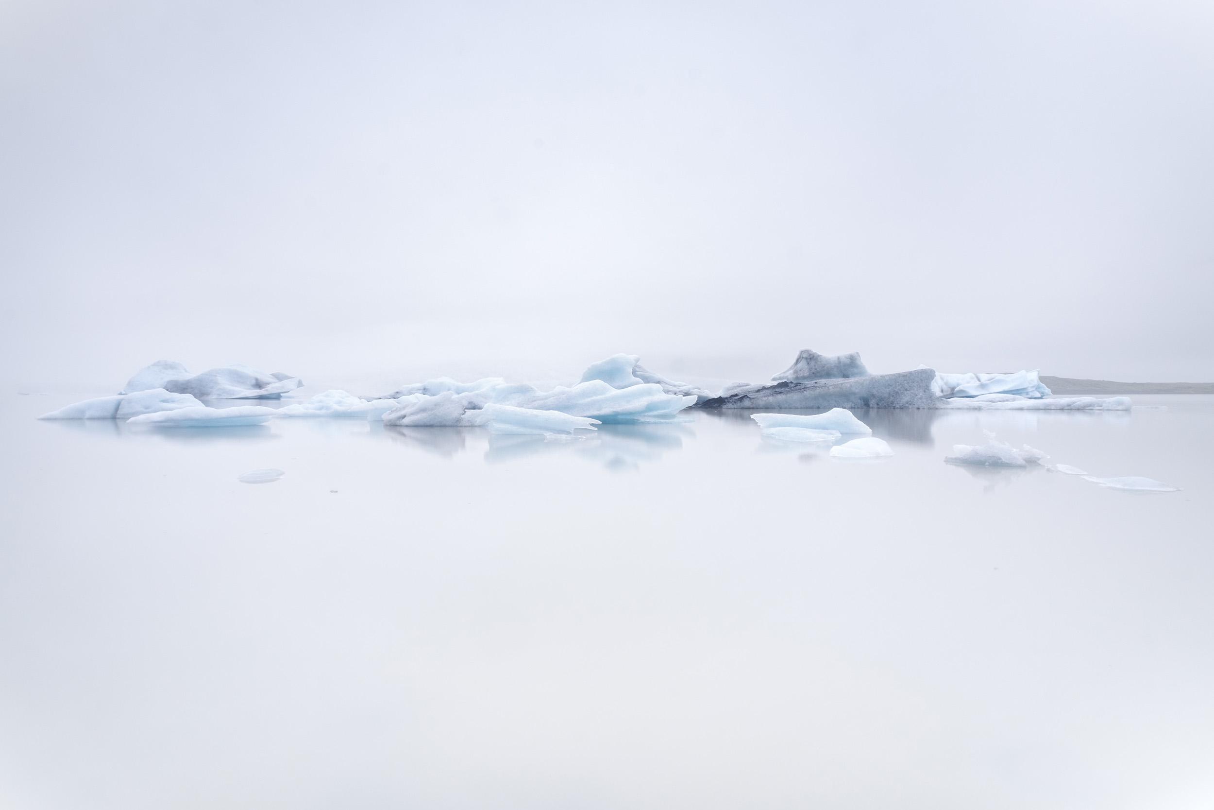 Fjallsarlon  Icebergs float on the glacier lake of Fjallsarlon on a misty day in southern Iceland