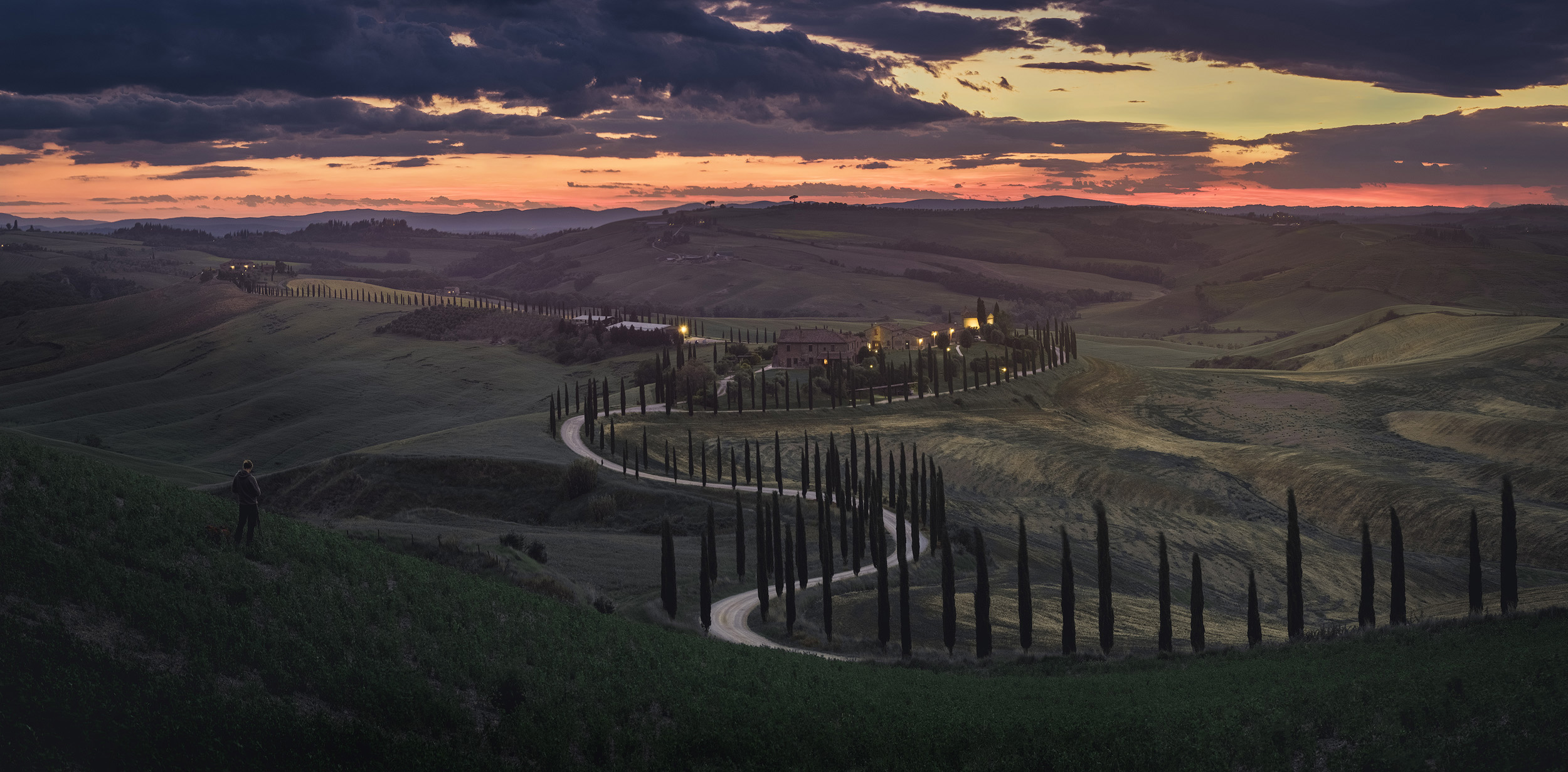 Crete Senesi   Sunset in Crete Senesi. The barren hills and winding tree lined roads here have a very different feel to the more lush and familiar Val d'Orcia a little to the south
