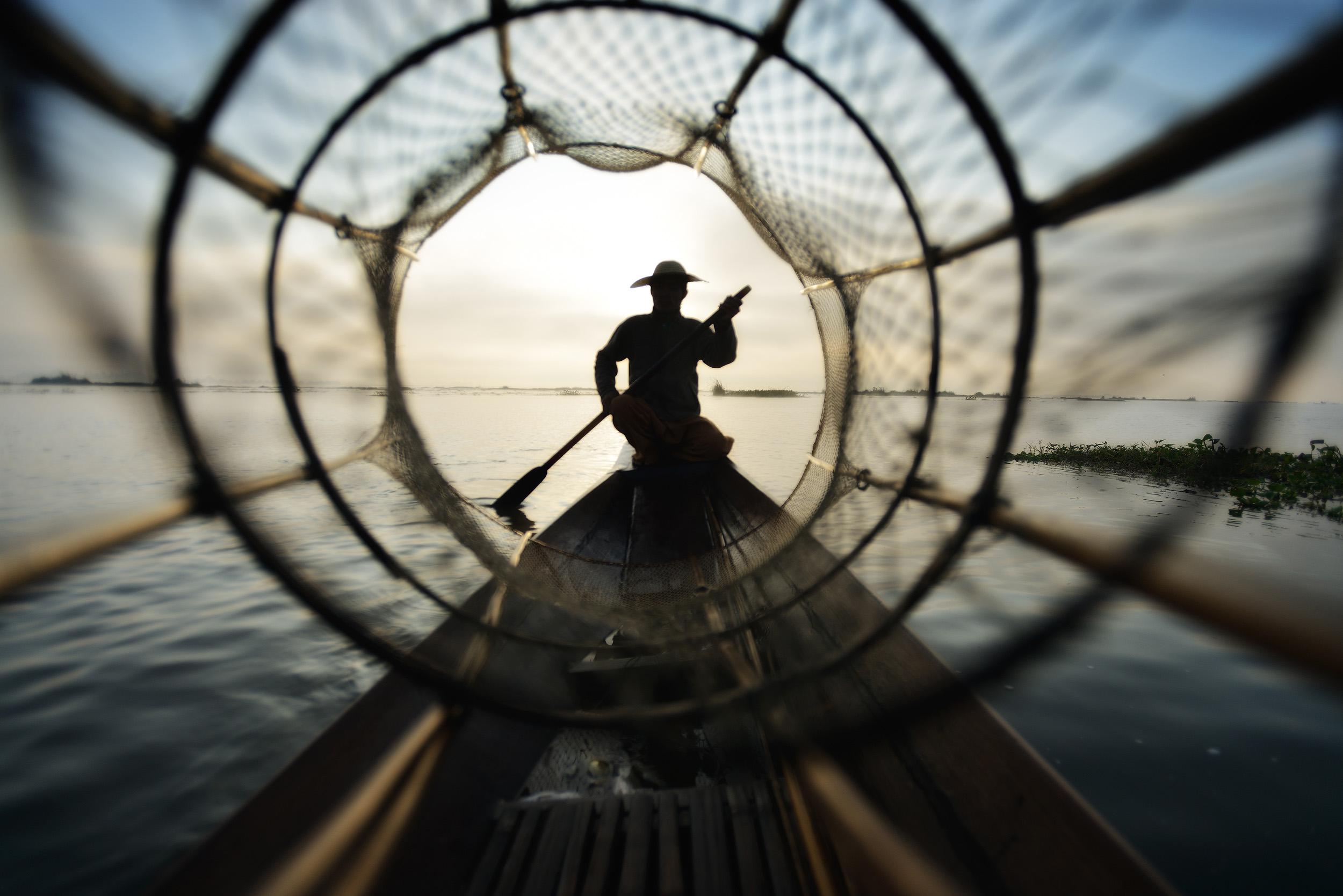 The Net   Looking through a fishermen's basket net on Lake Inle