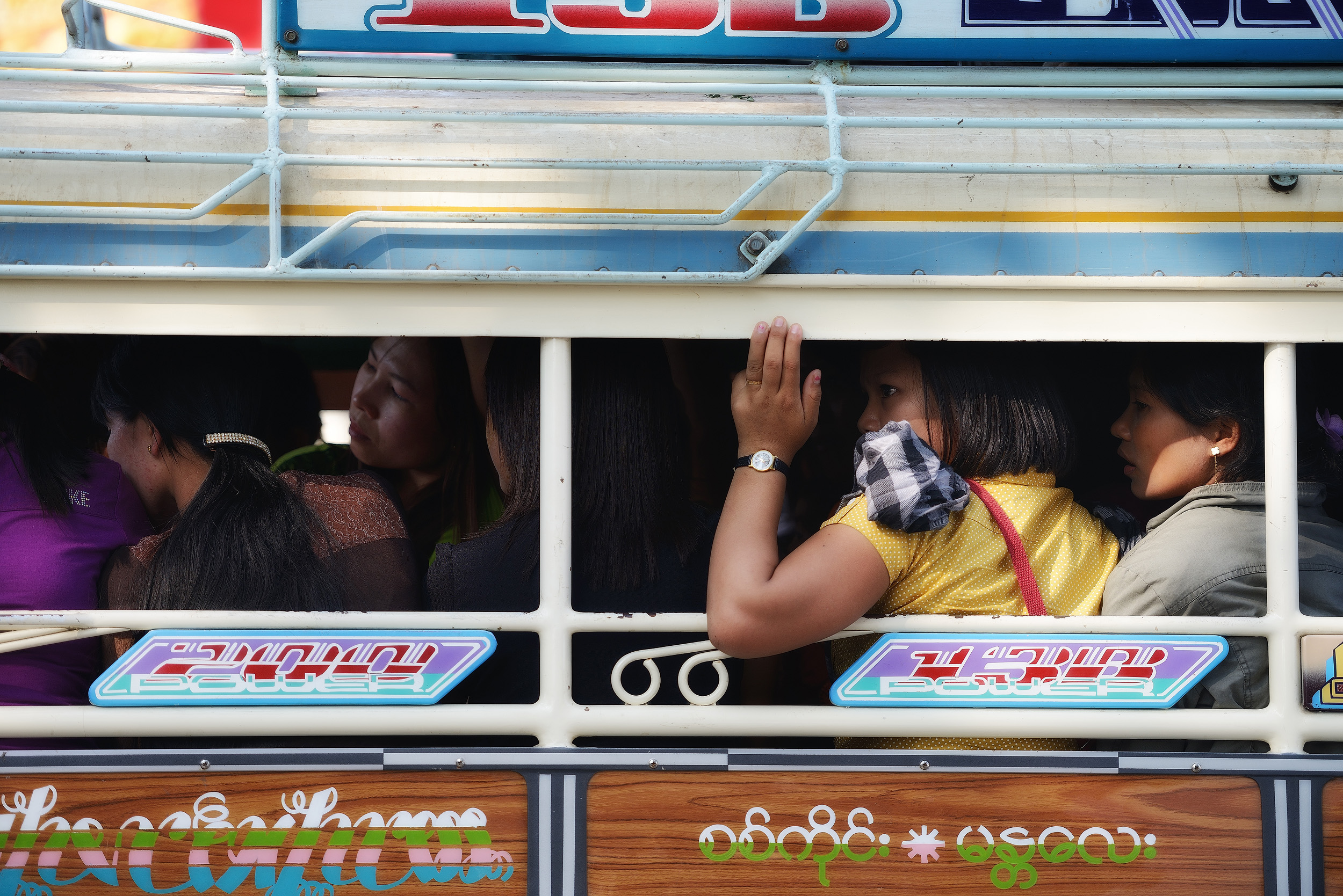 Mandalay   A crowded bus outside a temple in Mandalay