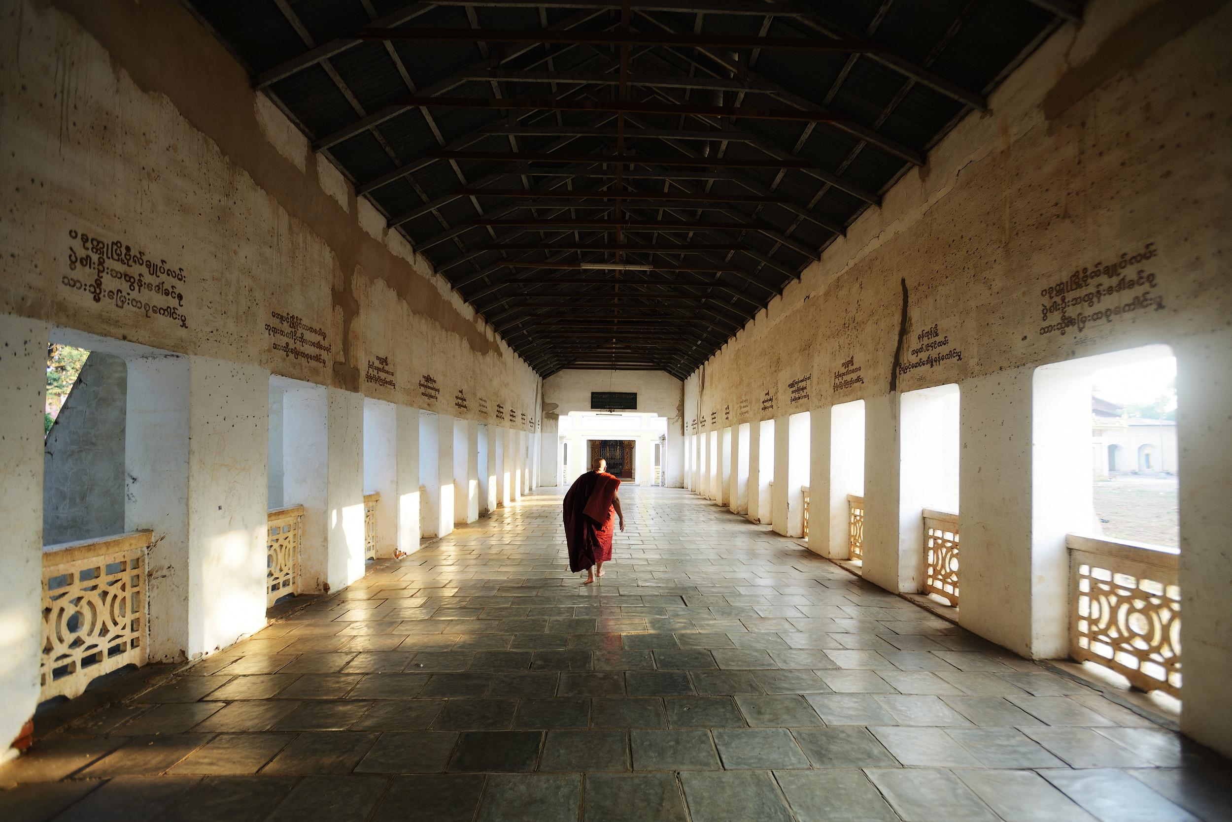 Shwezigon   A monk walks along the corridor at Shwezigon Pagoda, Bagan