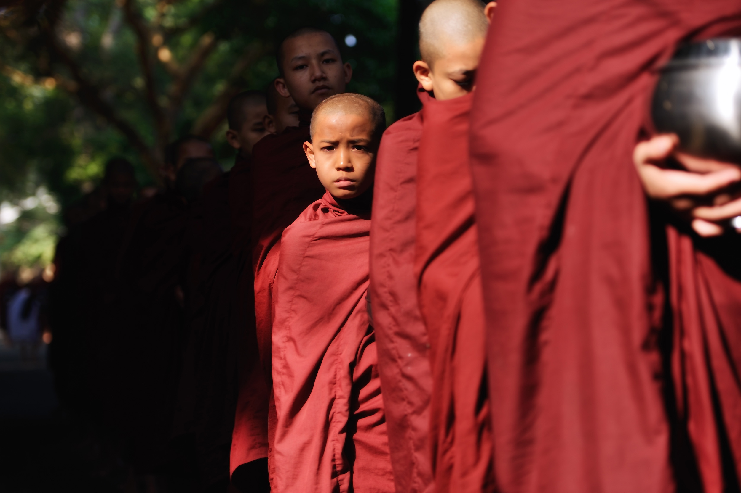 Mahagandayon Monks   Long lines of monks line up outside the dining hall in Mahagandayon Monastery, Amarapura