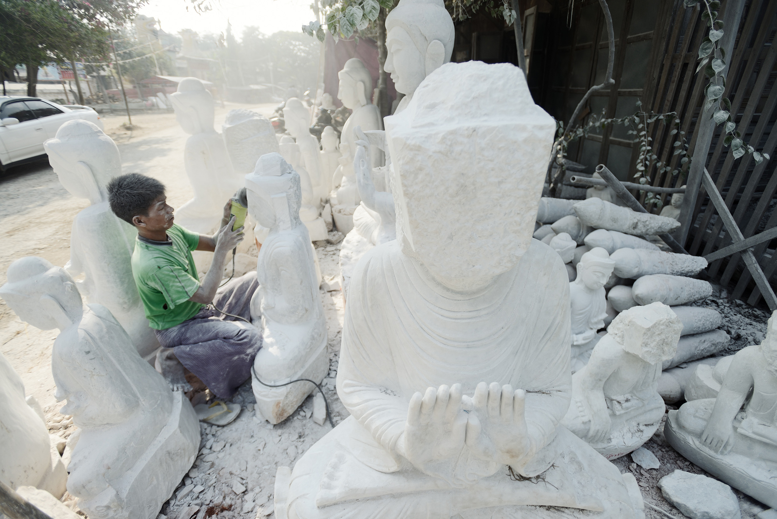 The Stone Carver II   Another image of the stone carver shaping lumps of stone into Buddhas on the streets of Amarapur