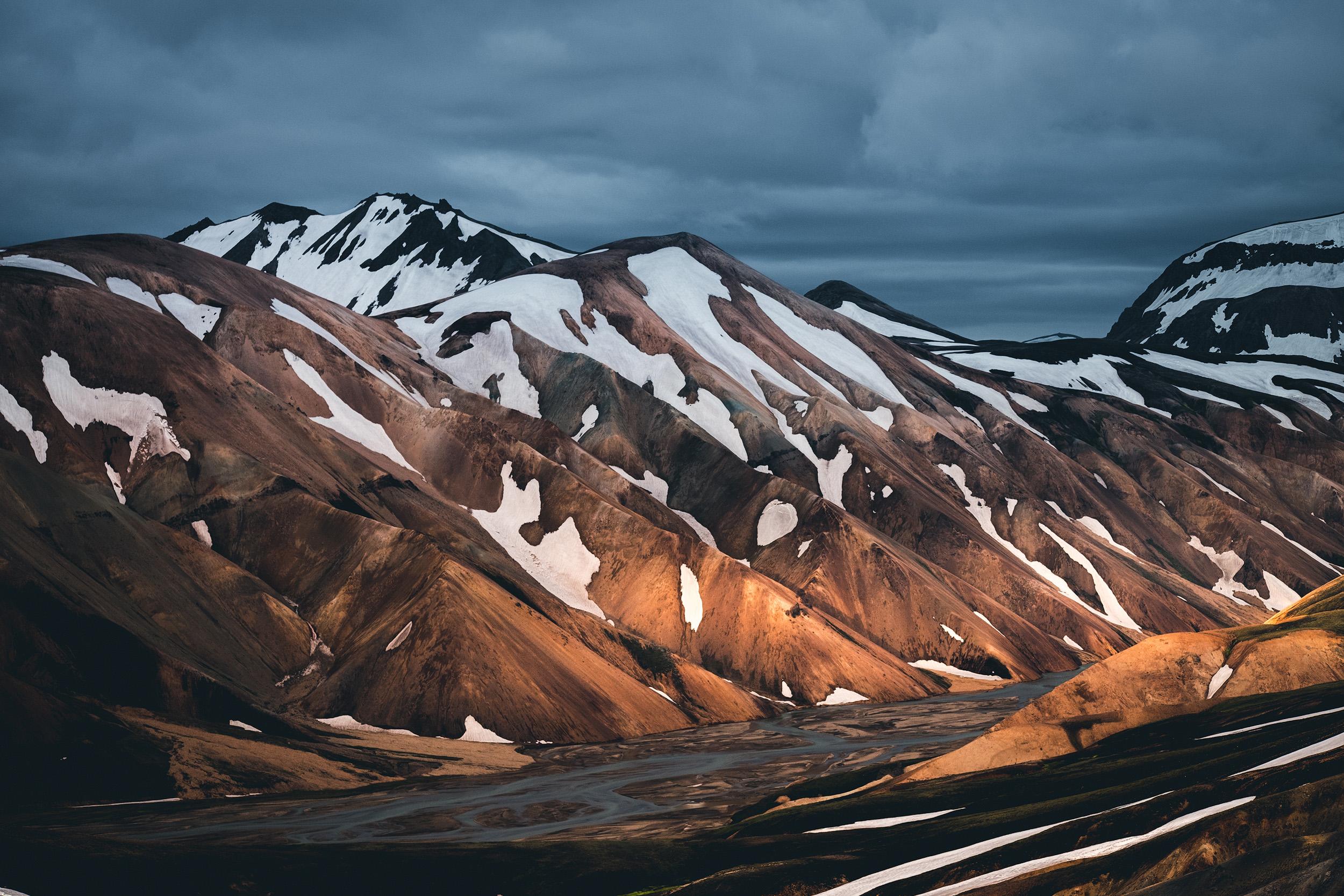 Landmannalaugar  Last light illuminates the Jokulgil river valley and the rhyolite mountains of Landmannalaugar in the Icelandic highlands