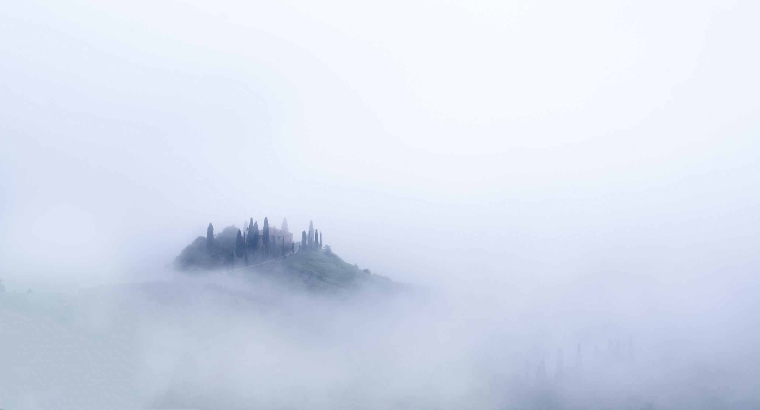 Dawn mist and fog swirls around Belvedere farmhouse