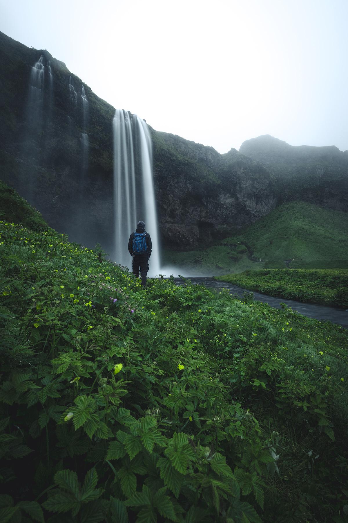 A self-portrait at the waterfalls of Seljalandsfoss.