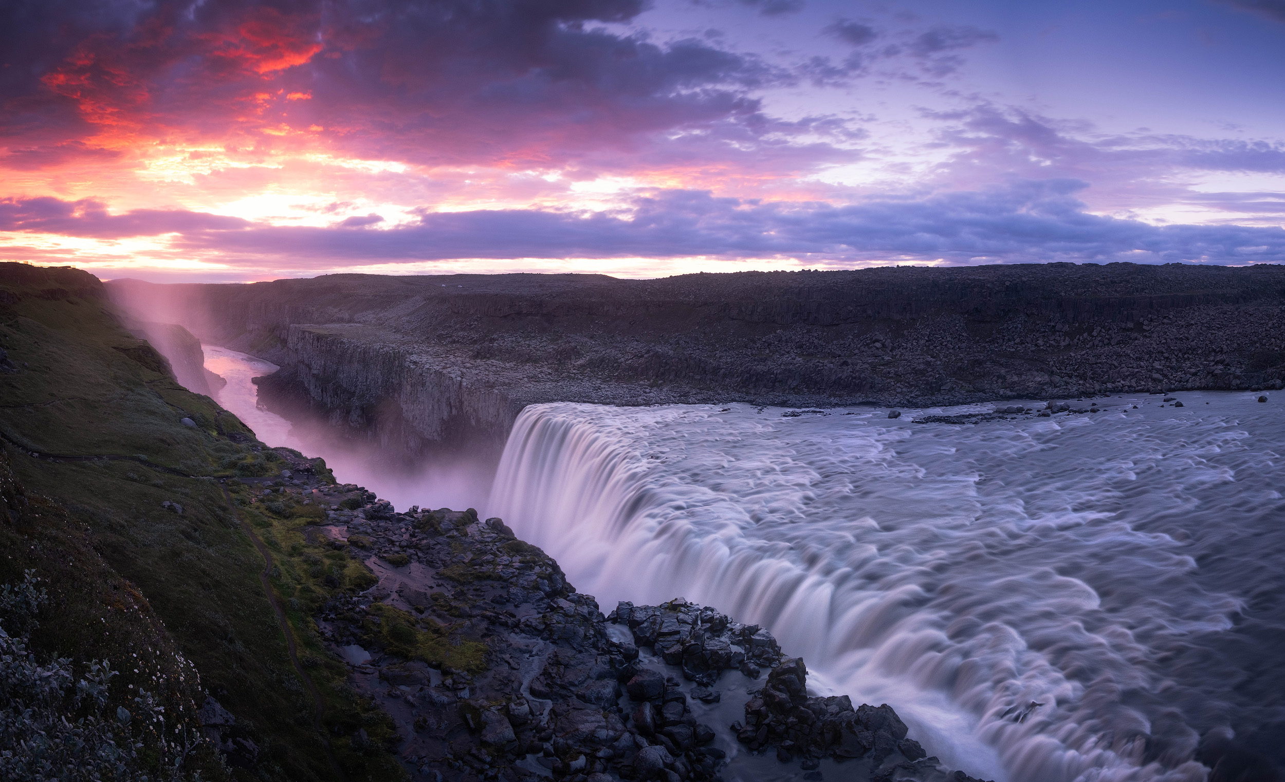 A panoramic shot of the sunrise at the Dettifoss falls