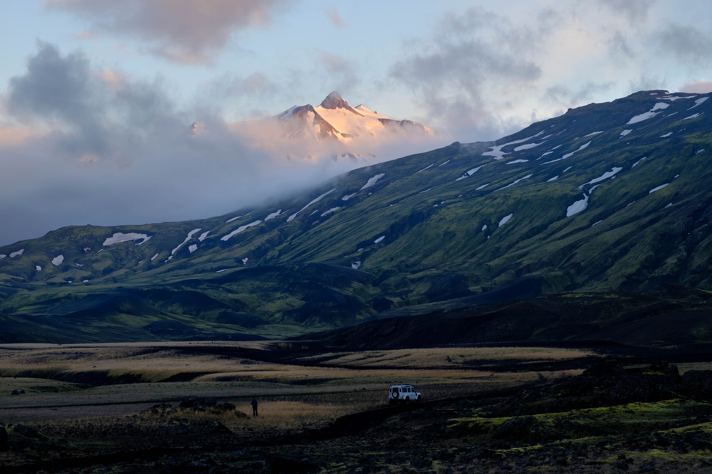 Clouds at sunrise around the peaks of Tindfjöll with our Land Rover parked below