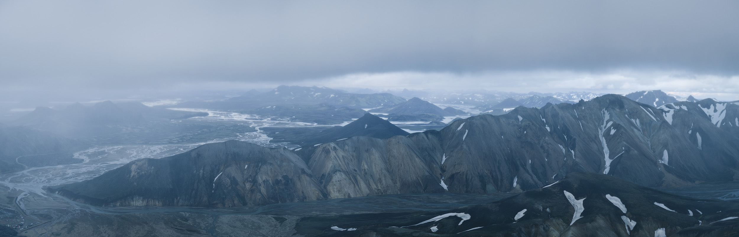 The view from on top of Blajnukur, overlooking the Landmannalaugar valley as rain and mist set in.