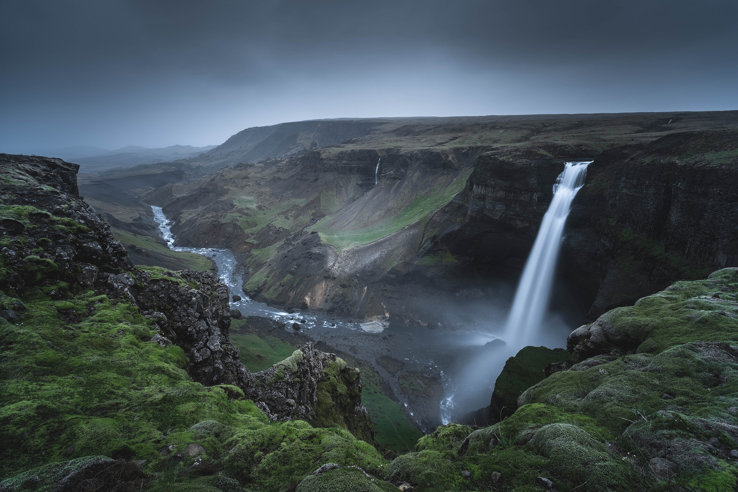The waterfalls at Haifoss as mist rolls up the valley