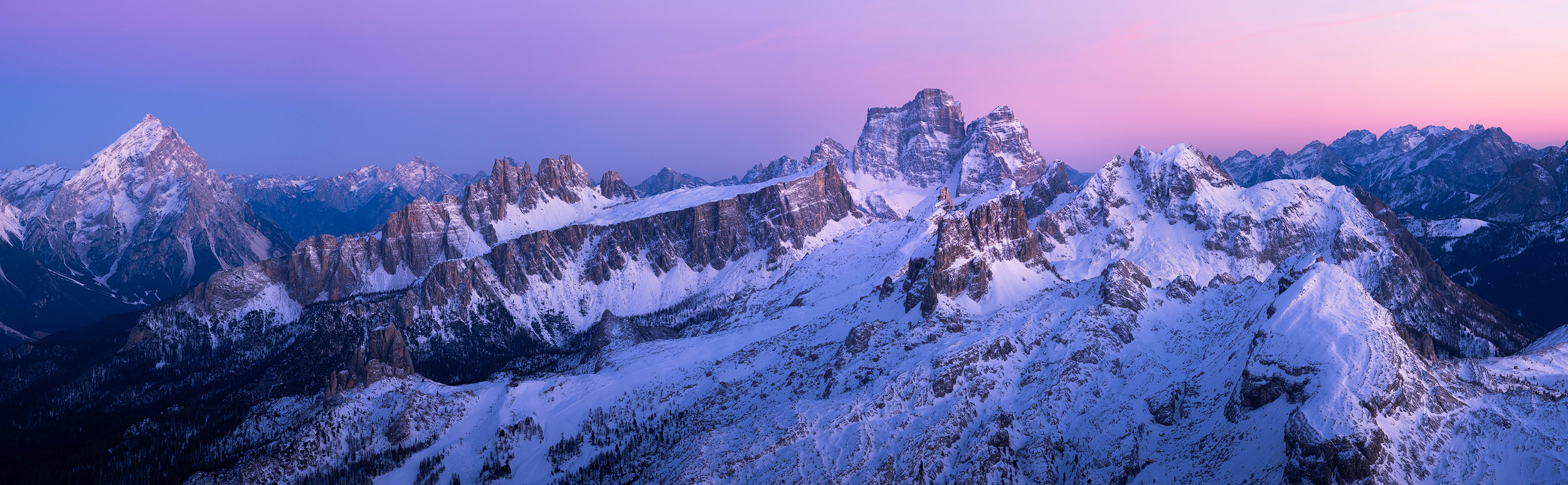 Lagazuoi Panorama   A panorama from the top of 2750m Lagazuoi just after the sun has gone down in the Dolomites. From the left there is the peak of Antelao, then the jagged spires of the ridge of Croda da Lago with the tall peak of Pelmo in the background. In front of Pelmo is Ra Gusela, the peak that towers above Passo Giau