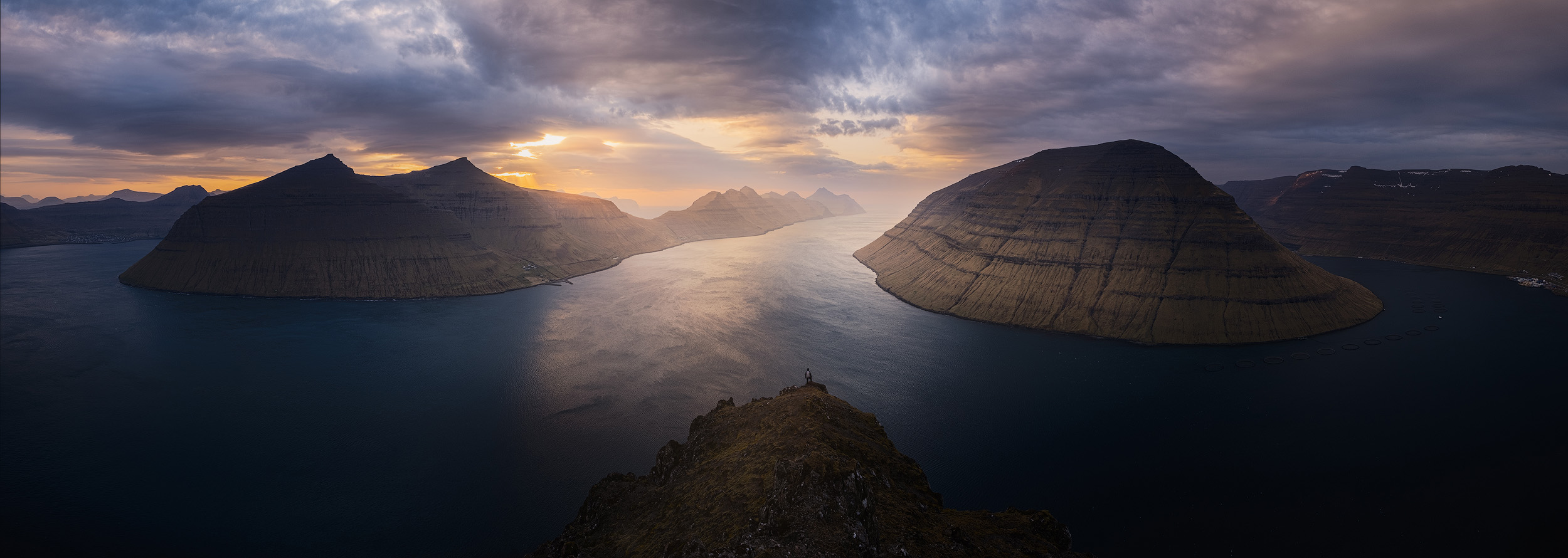 Klakkur Panorama   The islands of Kalsoy and Kunoy seen from the peak of Klakkur above the town of Klaksvík at sunset.