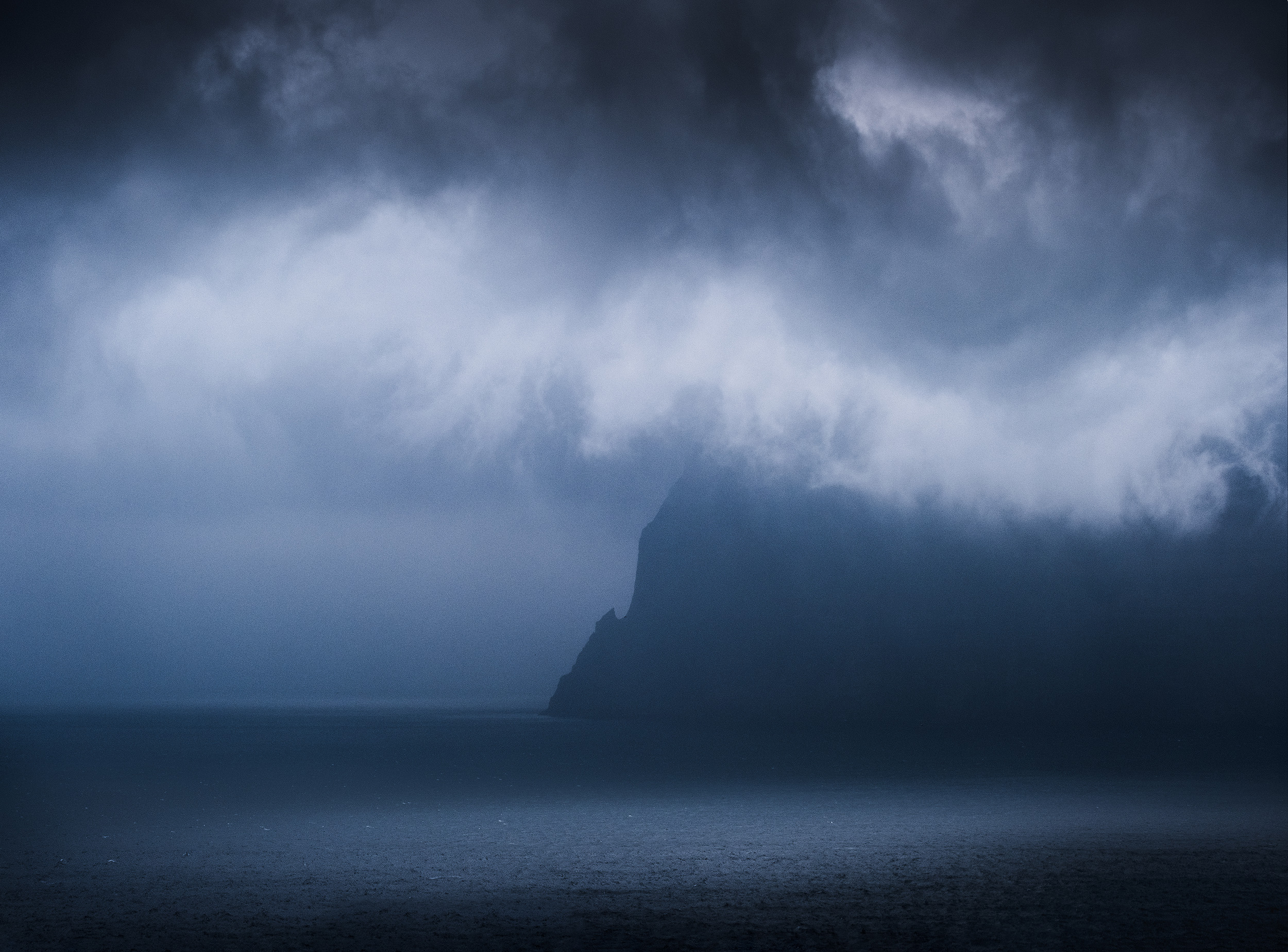 Kunoy   Storm clouds around the island of Kunoy, as seen from Trøllanes on neighbouring Kalsoy
