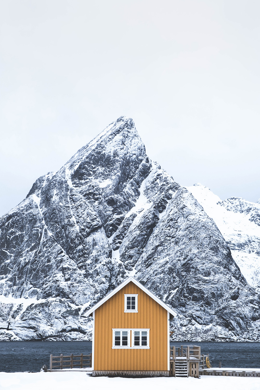 Sakrisøy   The iconic yellow cabin in Sakrisøy below the peaks of the Reinefjorden