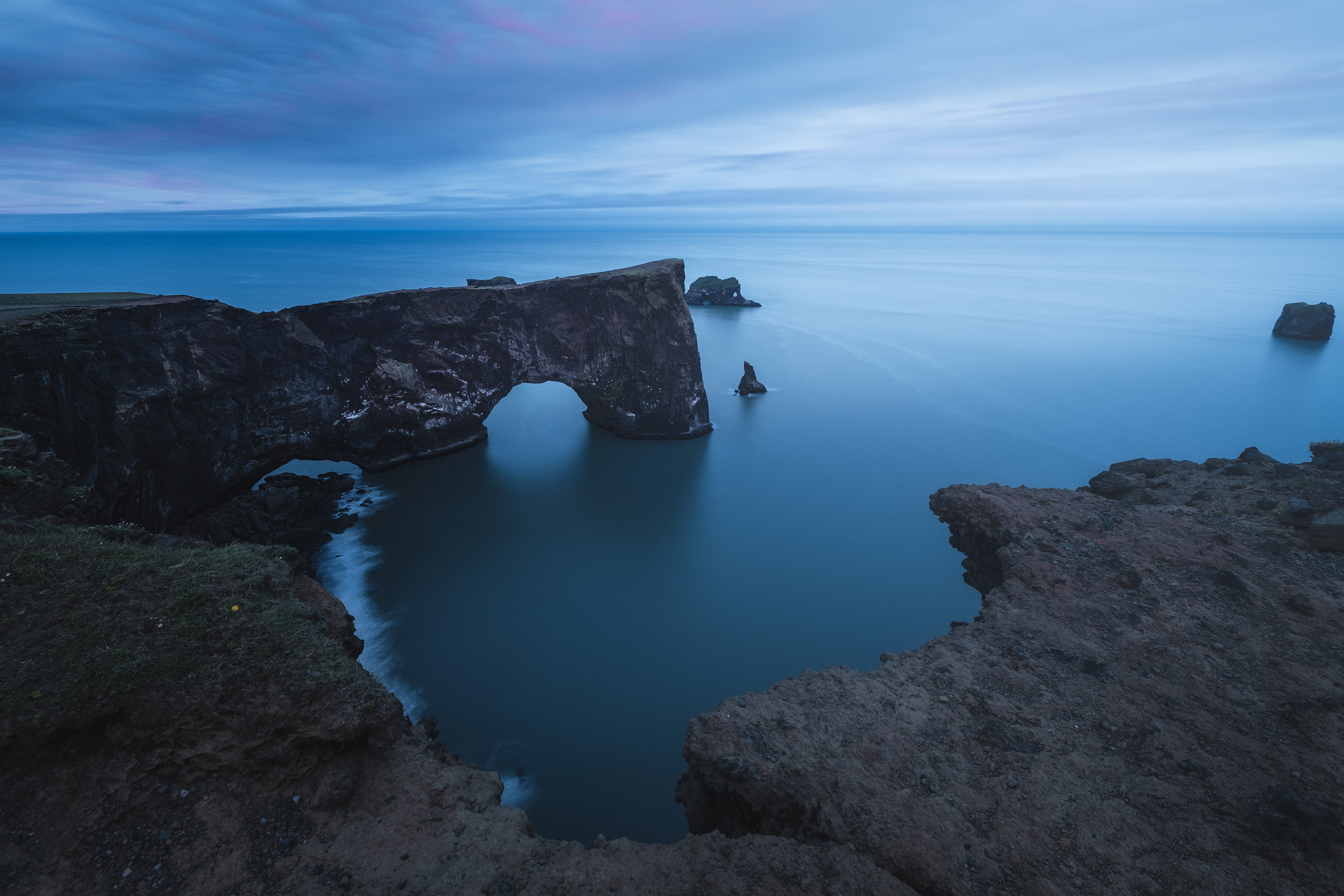 The rock arch of Dyrhólaey in the blue hour