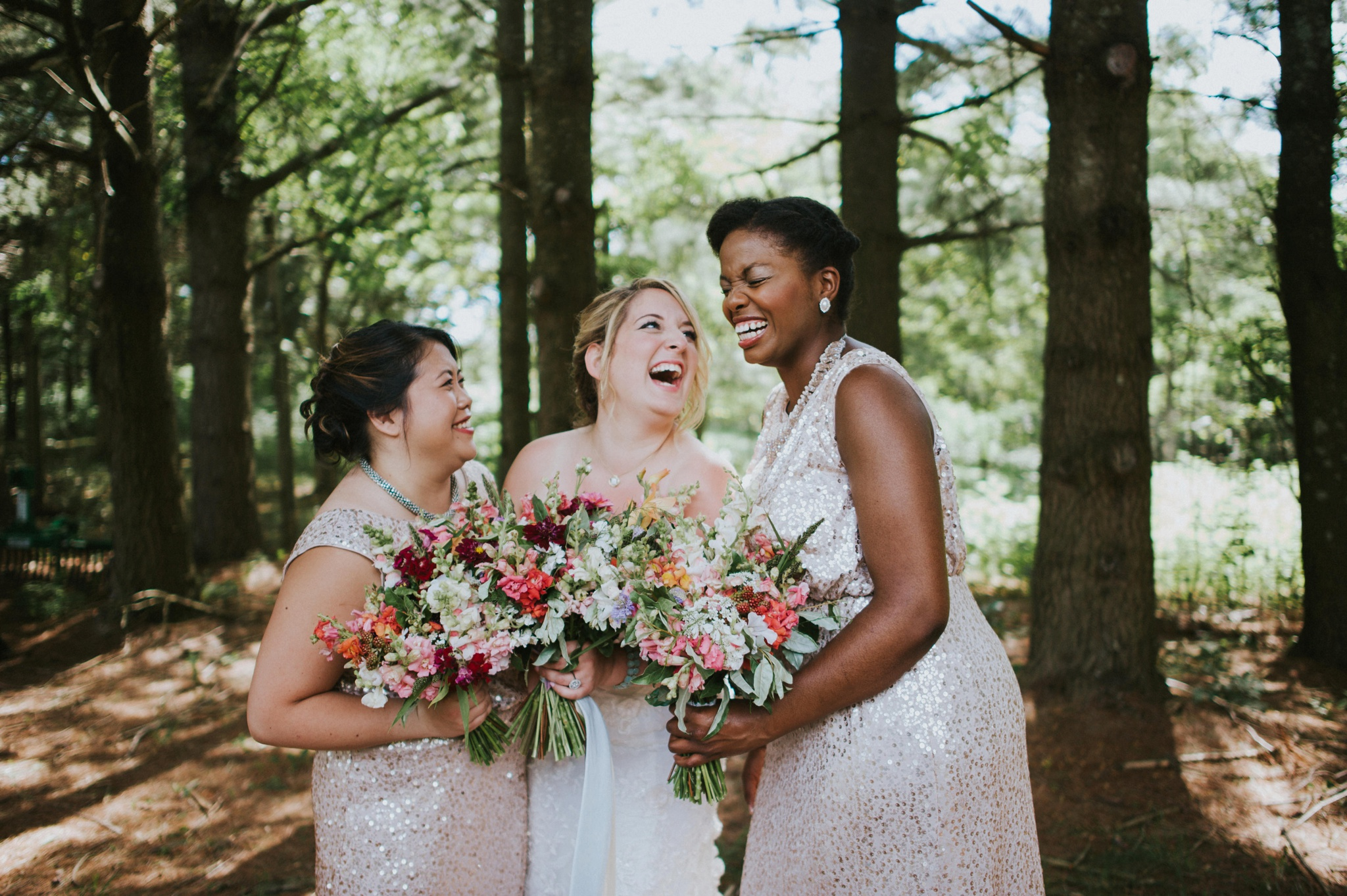 Bridesmaids laughing pose