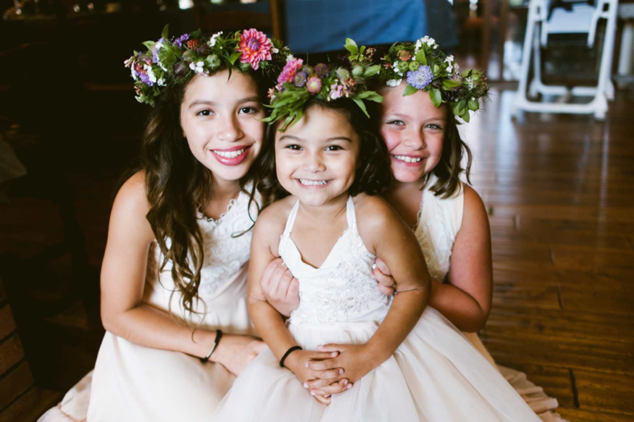 Junior bridesmaids wearing flower crowns
