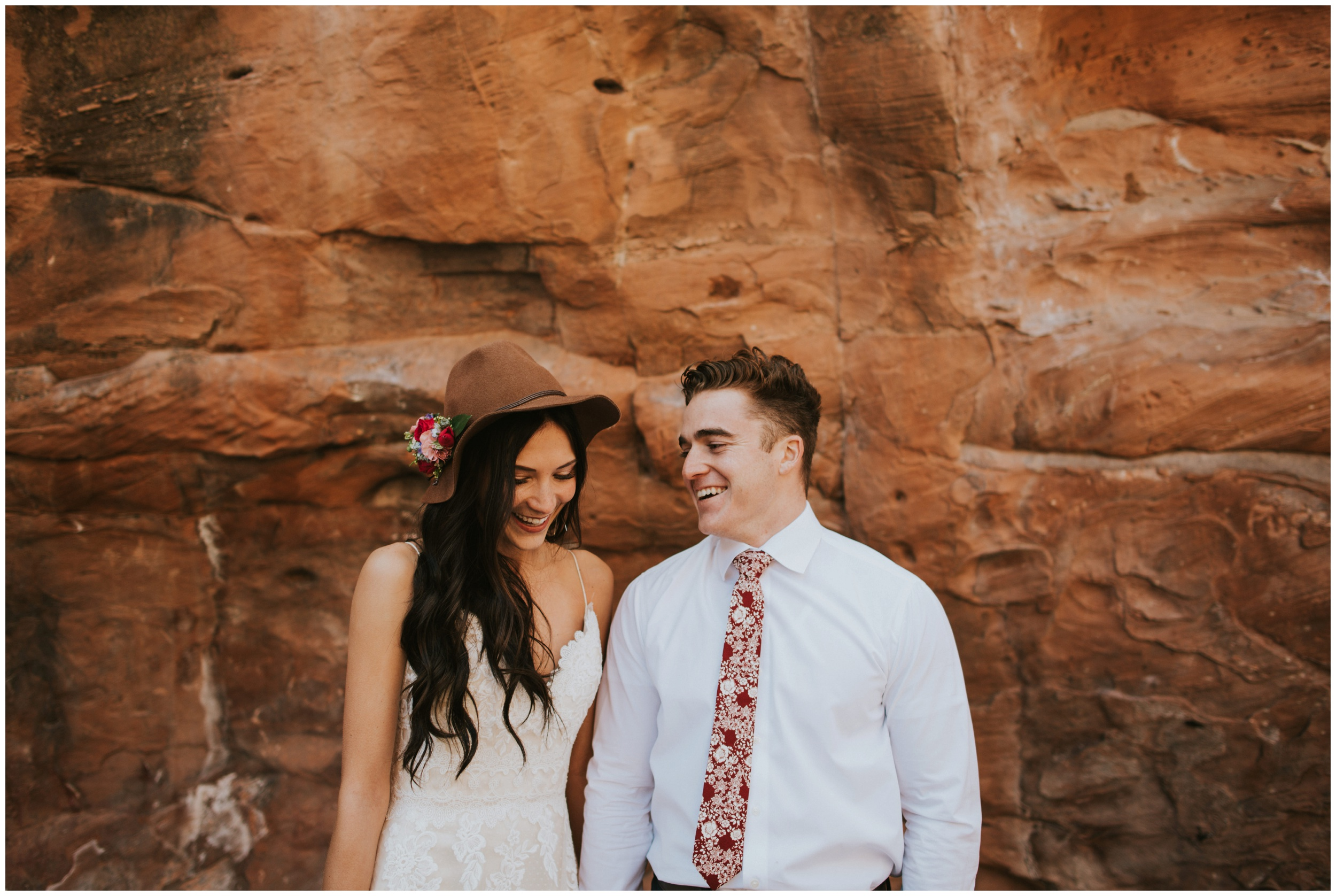 Cute couple in love, laughing at red rock canyon | wedding photographer www.riversandroadsphotography.com