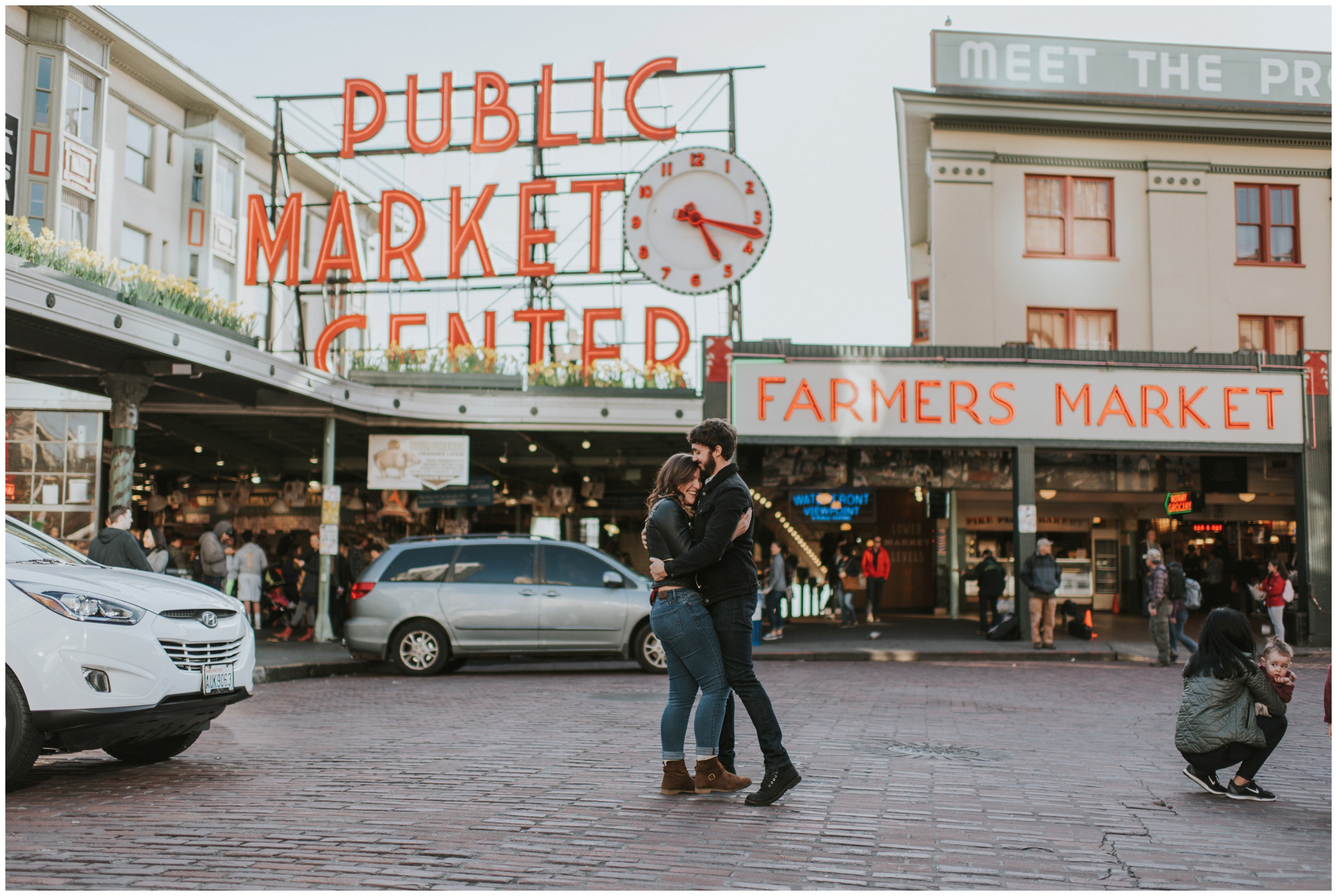 Couple posing at Pikes Place Market Seattle Washington | Seattle Engagement Photographer www.riversandroadsphotography.com