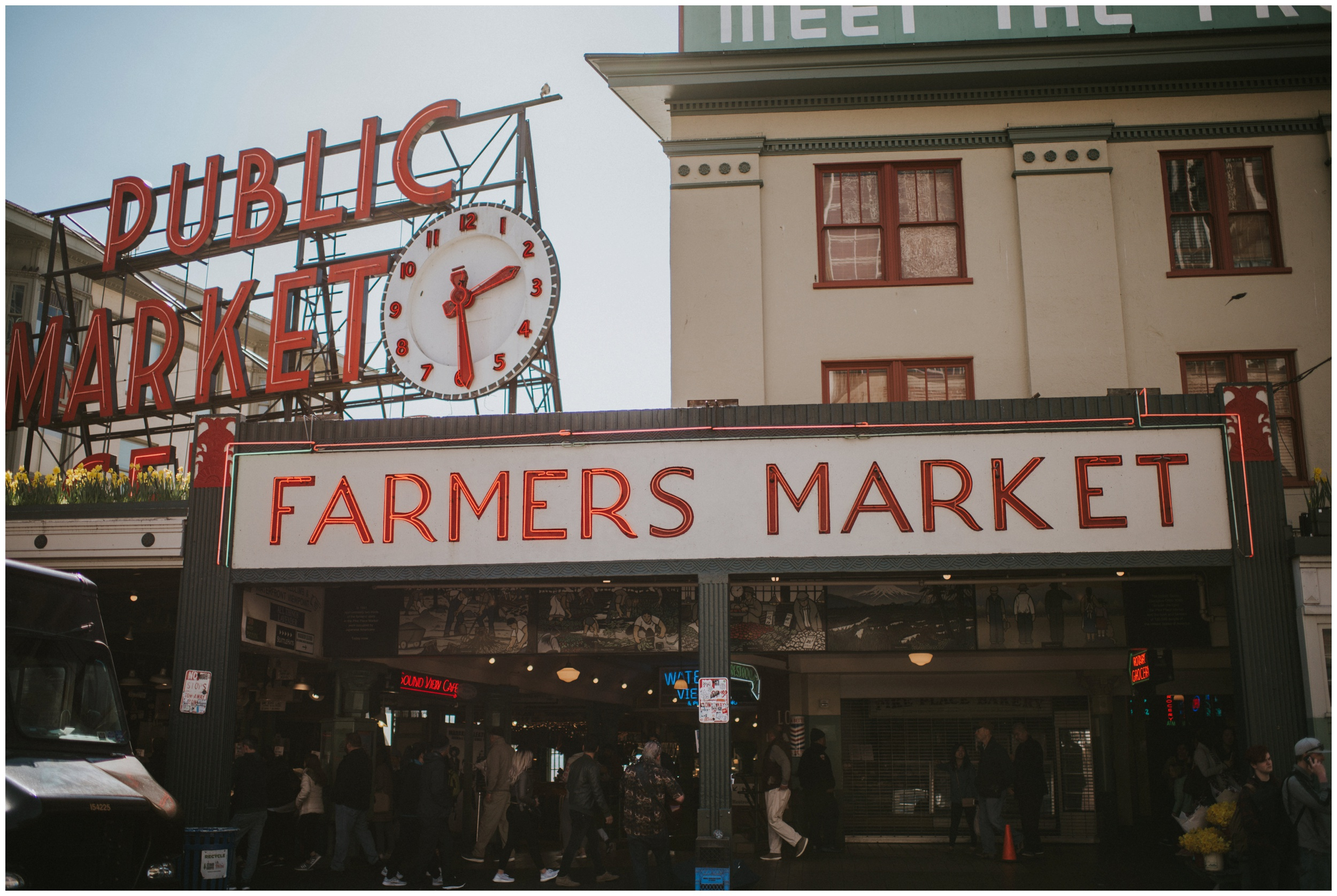 Farmers Market sign at Pike Place Market in Seattle Washington | Seattle Engagement Photographer www.riversandroadsphotography.com