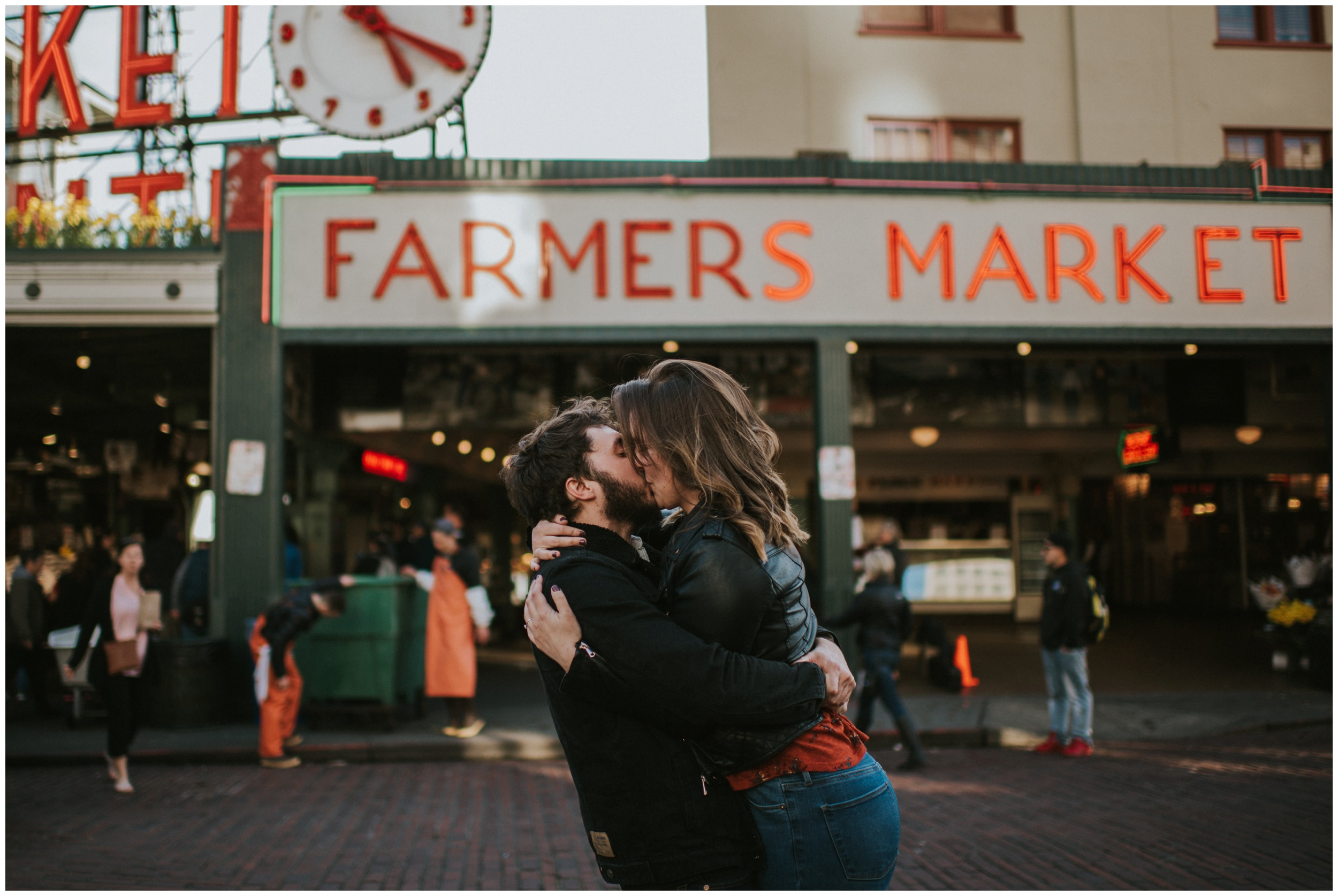 couple kissing, guy picking girl up, pike place market Seattle Washington  | Seattle Engagement Photographer www.riversandroadsphotography.com