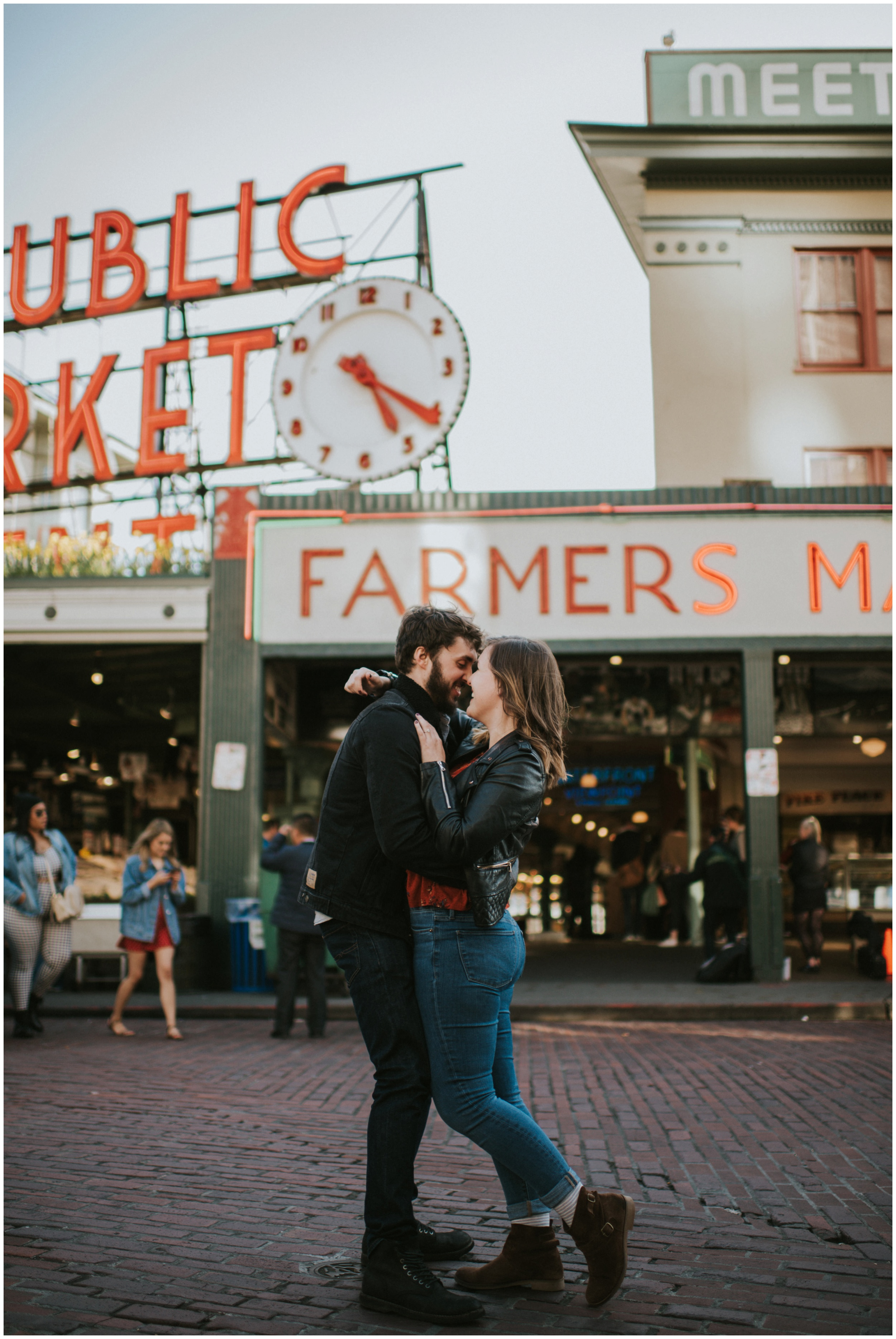 Engagement photos at Pike Place Market  | Seattle Engagement Photographer www.riversandroadsphotography.com