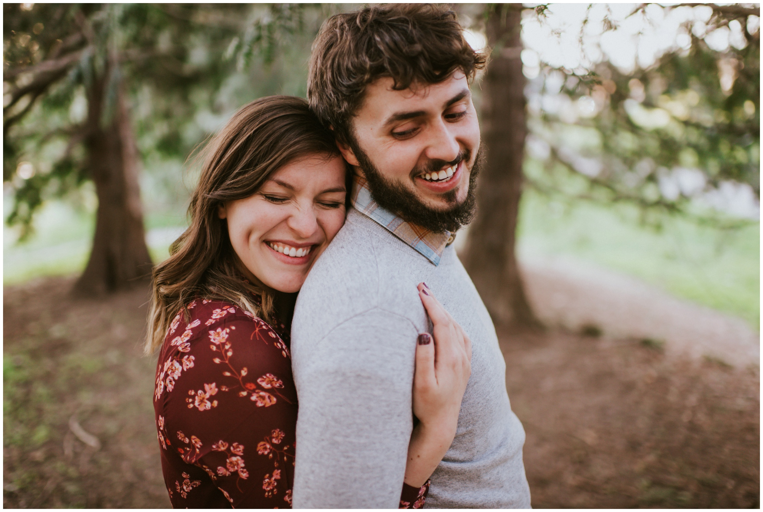couple cuddling in the forest  | Seattle Engagement Photographer www.riversandroadsphotography.com