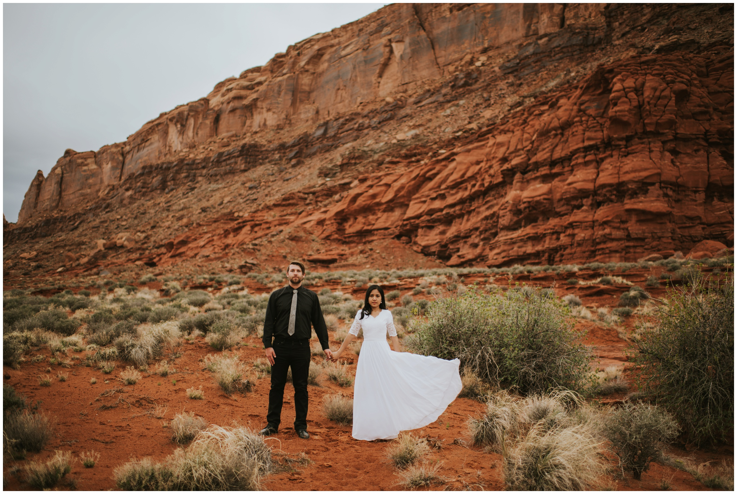 Moody portrait of a bride and groom in a canyon, rich colors |Moab Utah, Photographer www.riversandroadsphotography.com
