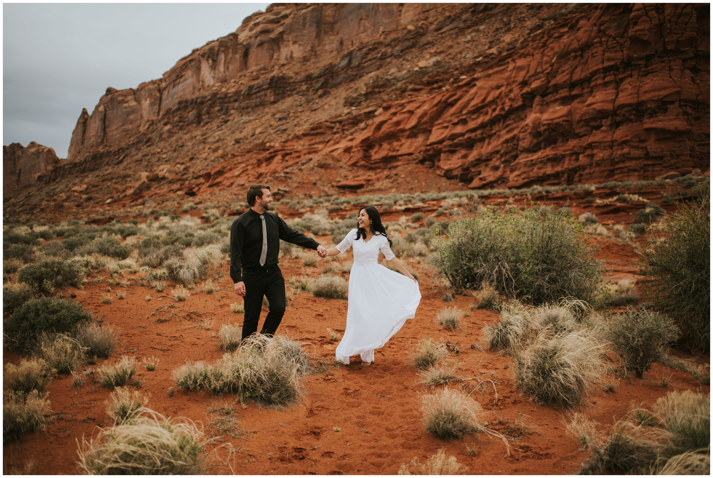 Couple dancing and playing in Moab canyon |Moab Utah, Photographer www.riversandroadsphotography.com