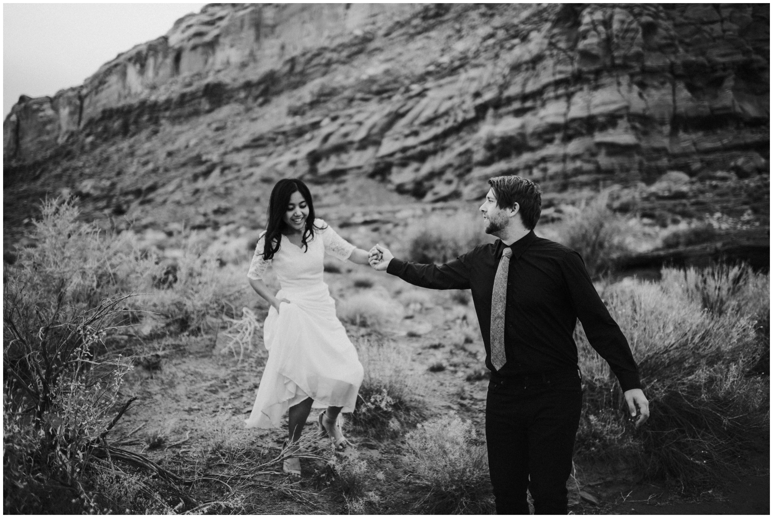 Groom helping bride, in between moments, candid photography |Moab Utah, Photographer www.riversandroadsphotography.com