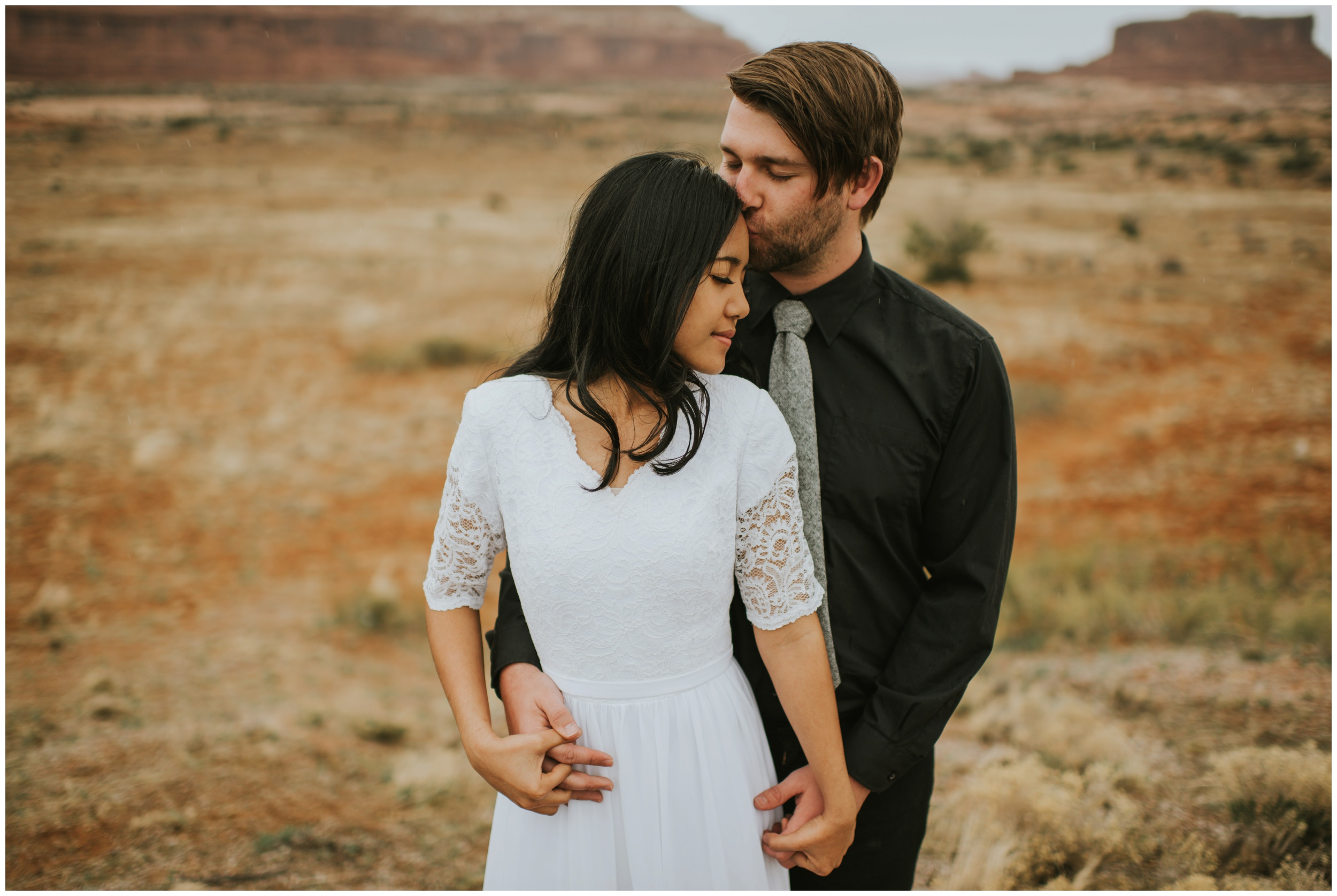 intimate portrait, sweet forehead kisses, candid photography |Moab Utah, Photographer www.riversandroadsphotography.com