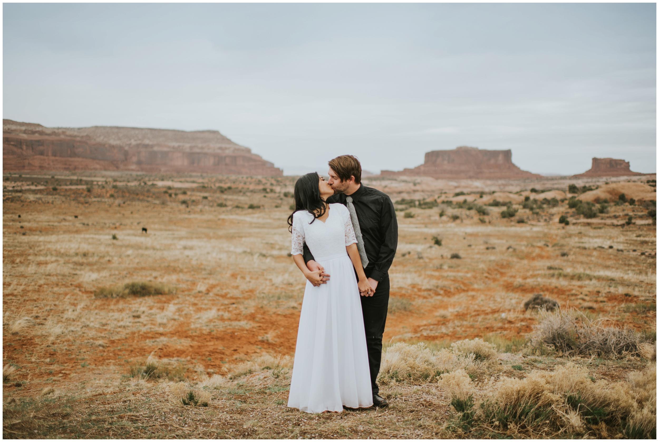 Couple kissing in the desert |Moab Utah, Photographer www.riversandroadsphotography.com