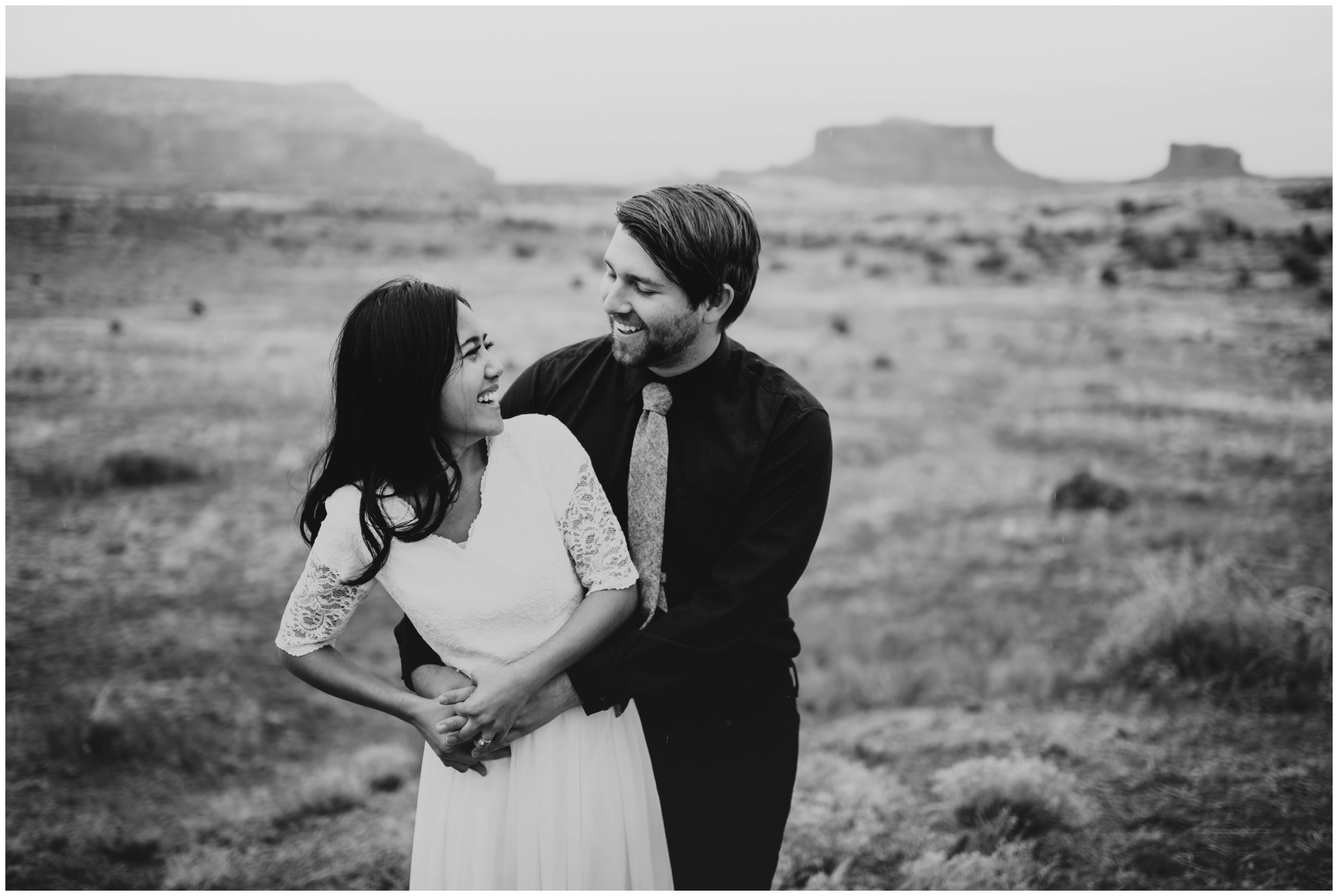 Adorable couple laughing, natural posing, candid photos |Moab Utah, Photographer www.riversandroadsphotography.com