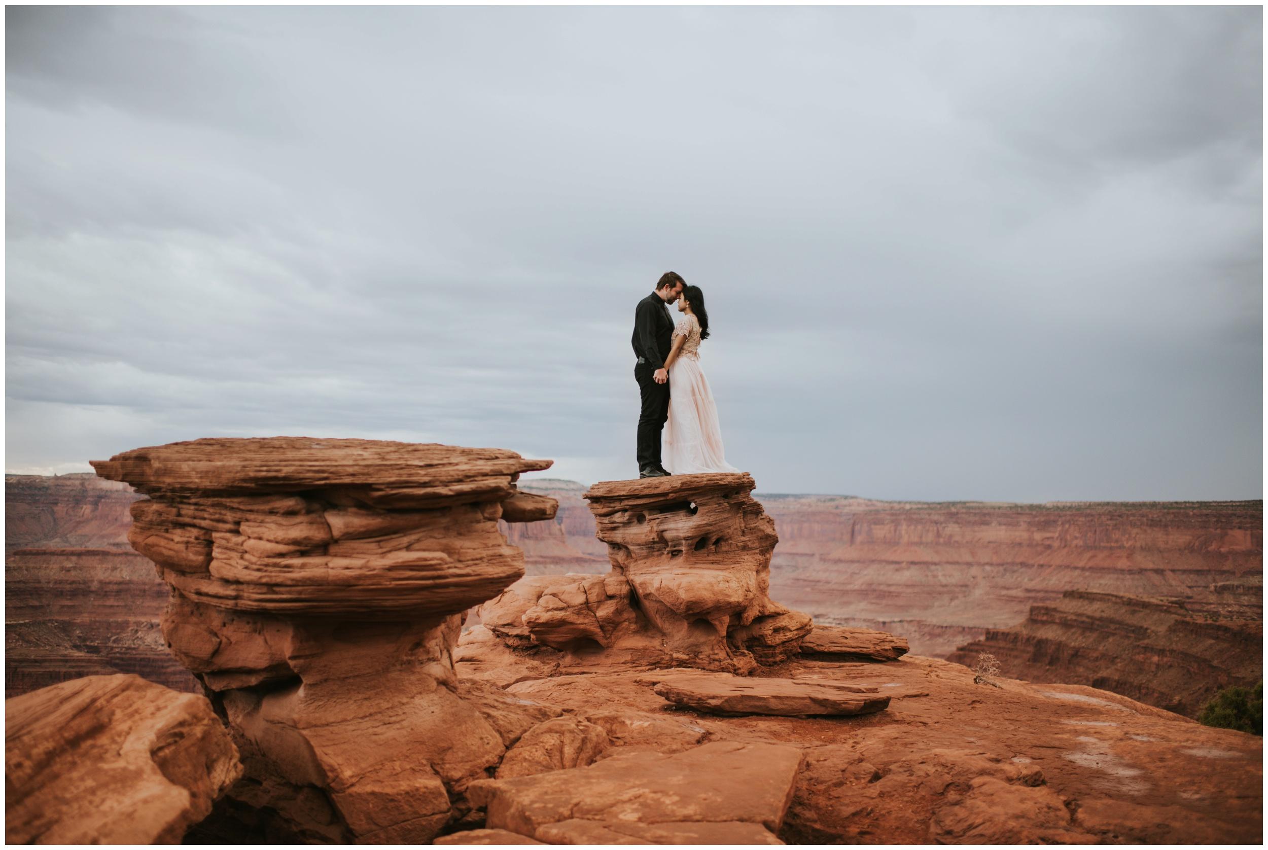 Beautiful landscape portrait of couple eloping at Dead Horse Point | Elopement Photographer www.riversandroadsphotography.com