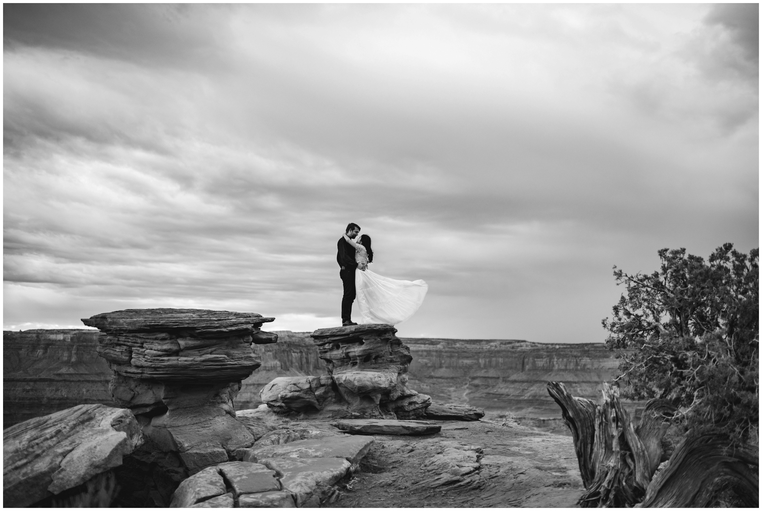 Wind blown dress on the side of a cliff at Dead Horse Point Moab, Utah | Elopement Photographer www.riversandroadsphotography.com