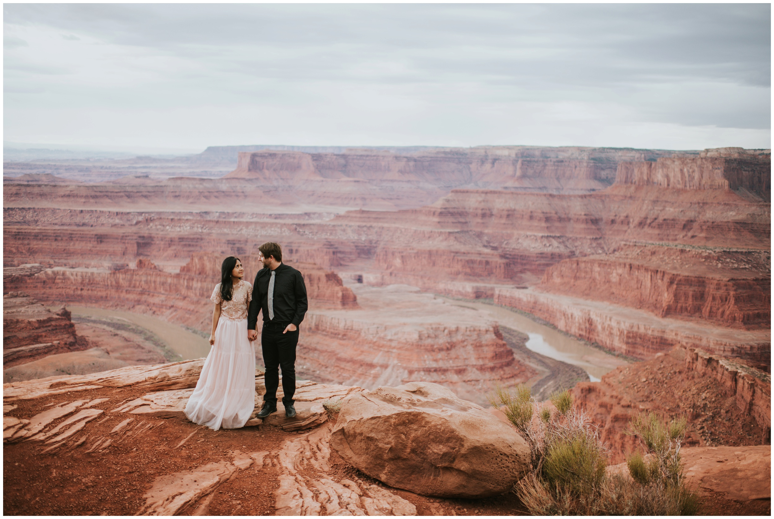 Beautiful view of Dead Horse Point State Park Overlook with couple | Elopement Photographer www.riversandroadsphotography.com