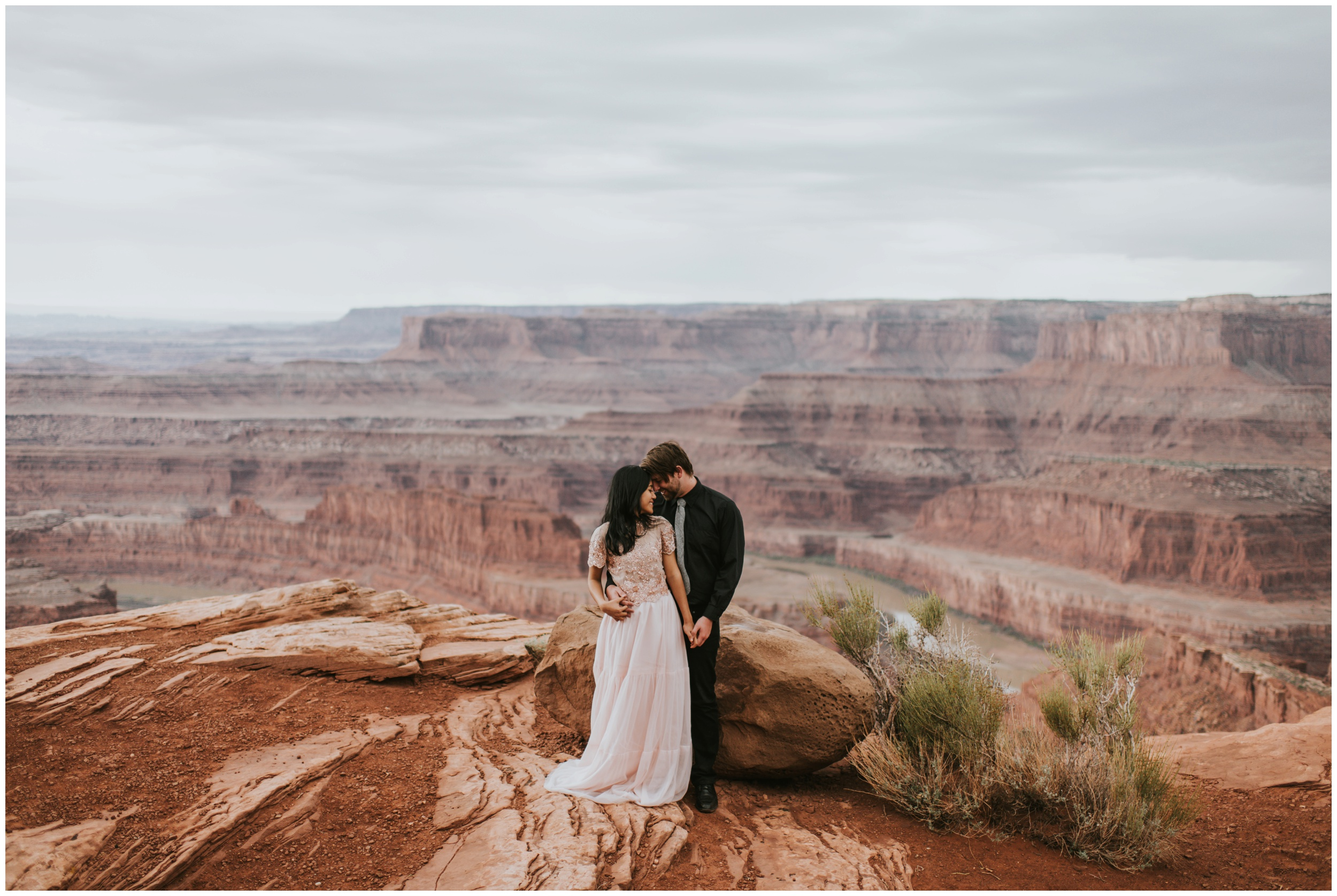 Couple holding each other after eloping at Dead Horse Point State Park Overlook | Elopement Photographer www.riversandroadsphotography.com