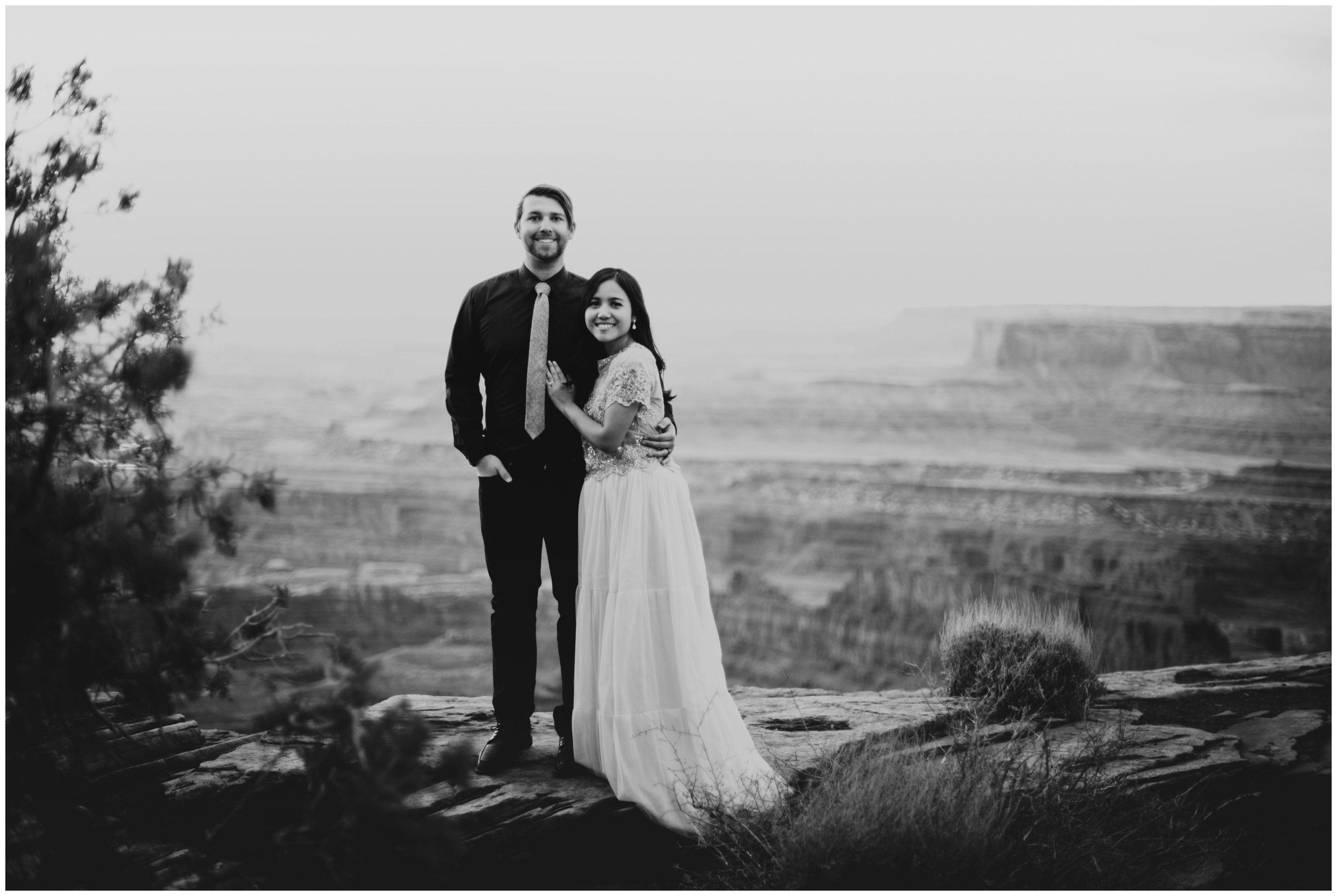 Bride and groom portraits at Dead Horse Point State Park Overlook | Elopement Photographer www.riversandroadsphotography.com