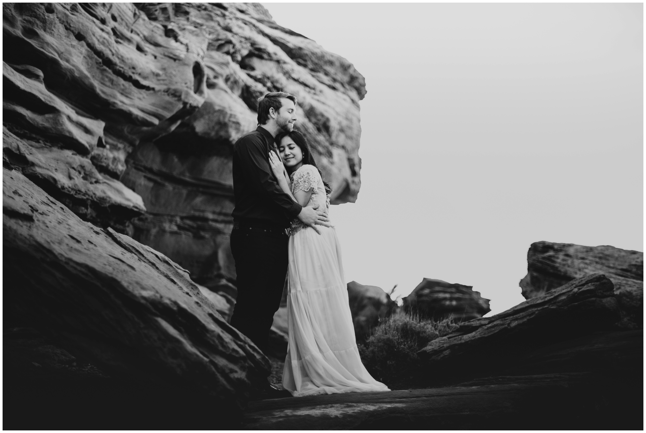 emotional black and white photo of couple holding each other at Dead Horse Point State Park | Elopement Photographer www.riversandroadsphotography.com