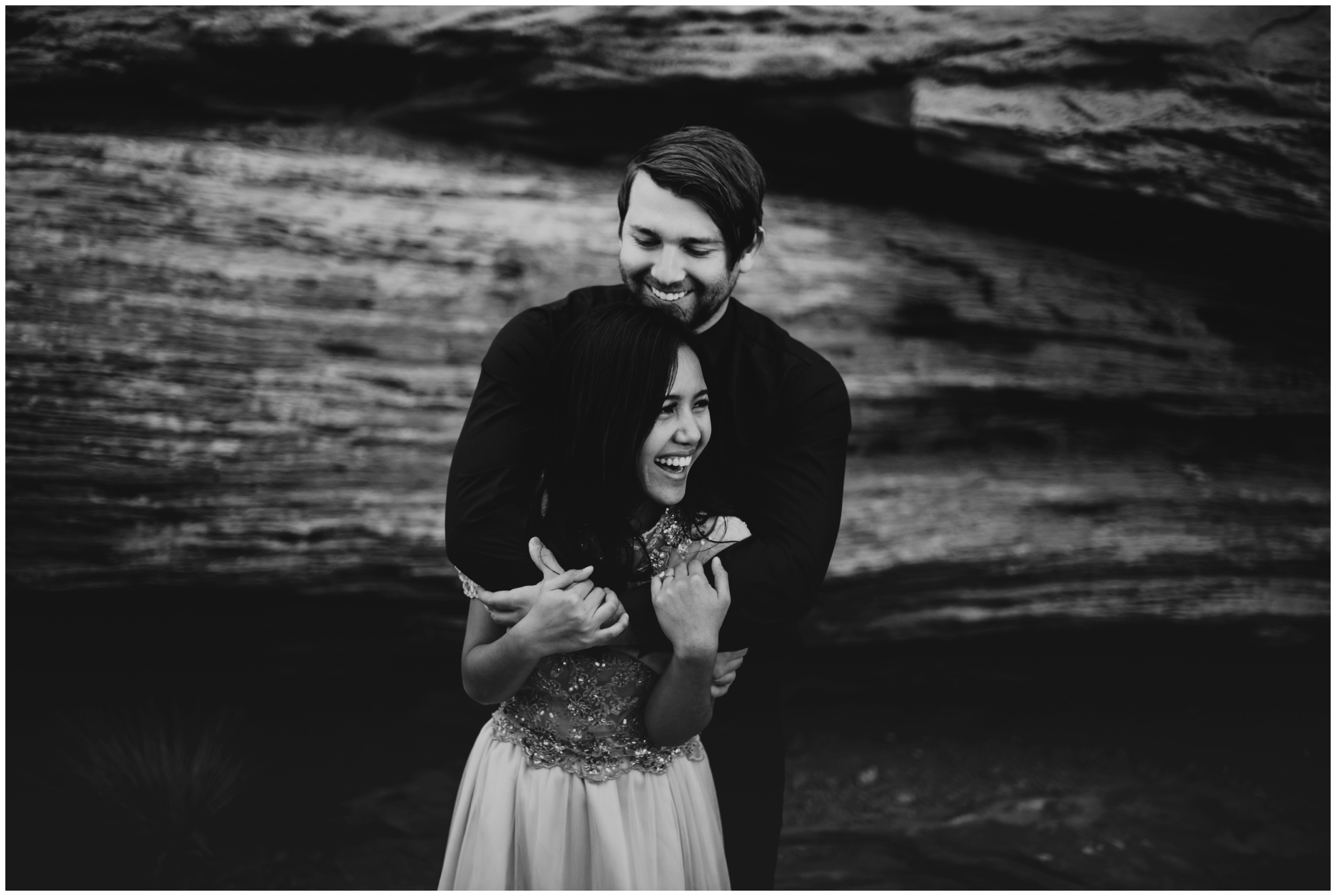 Bride and groom genuinely laughing during portraits | Elopement Photographer www.riversandroadsphotography.com