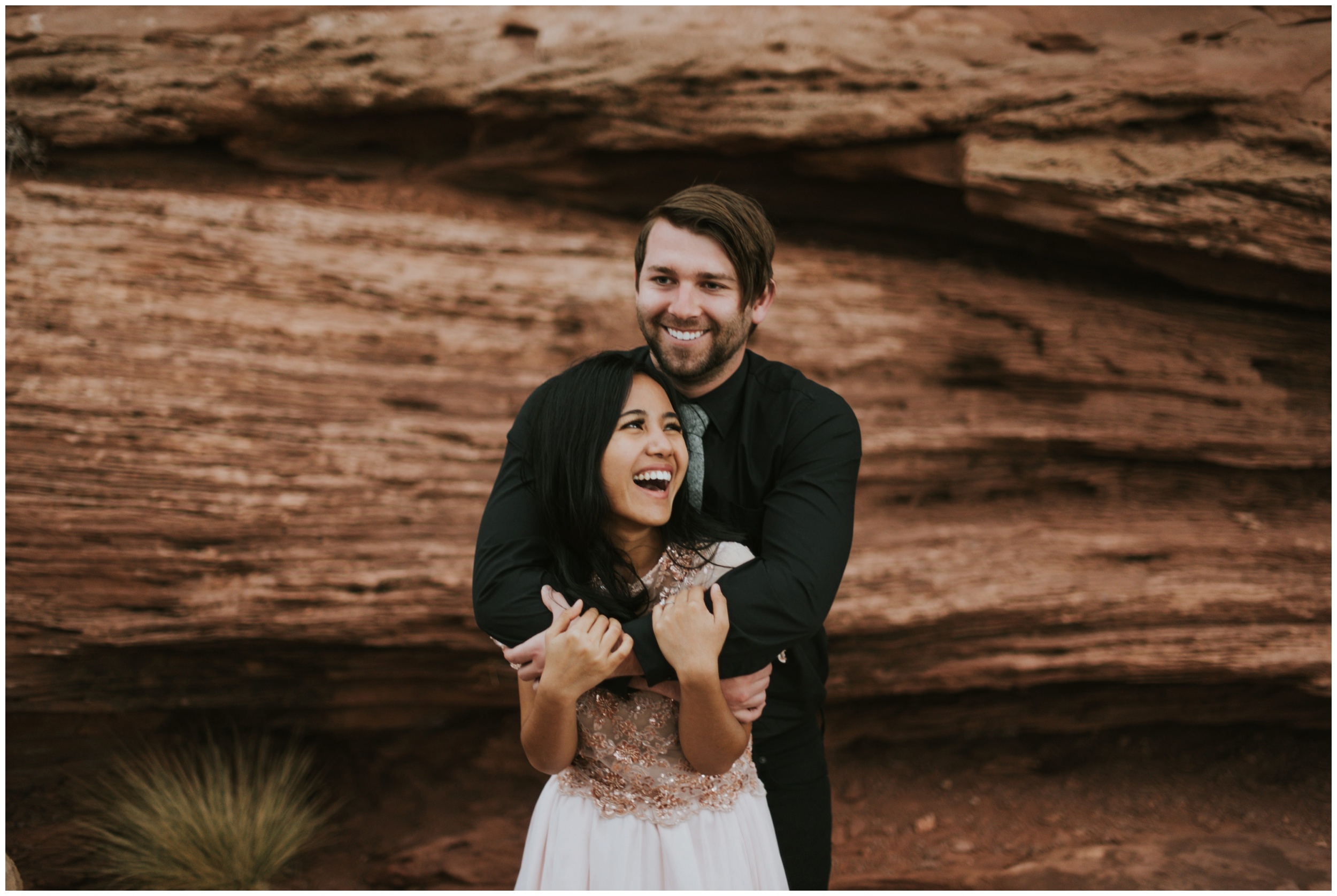 Guy wrapping girl up in his arms portrait photographer | Elopement Photographer www.riversandroadsphotography.com