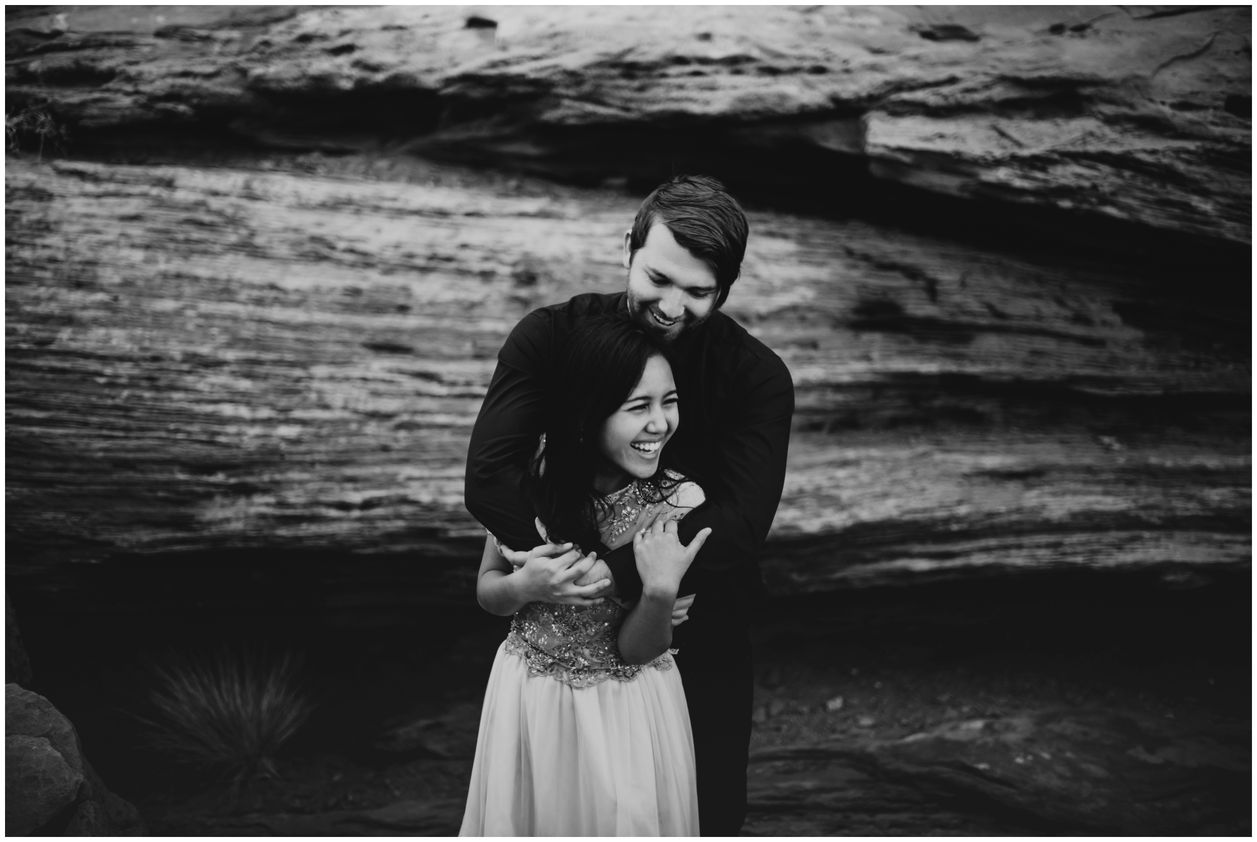 Couple laughing together during bridal portraits at Dead Horse Point State Park | Elopement Photographer www.riversandroadsphotography.com