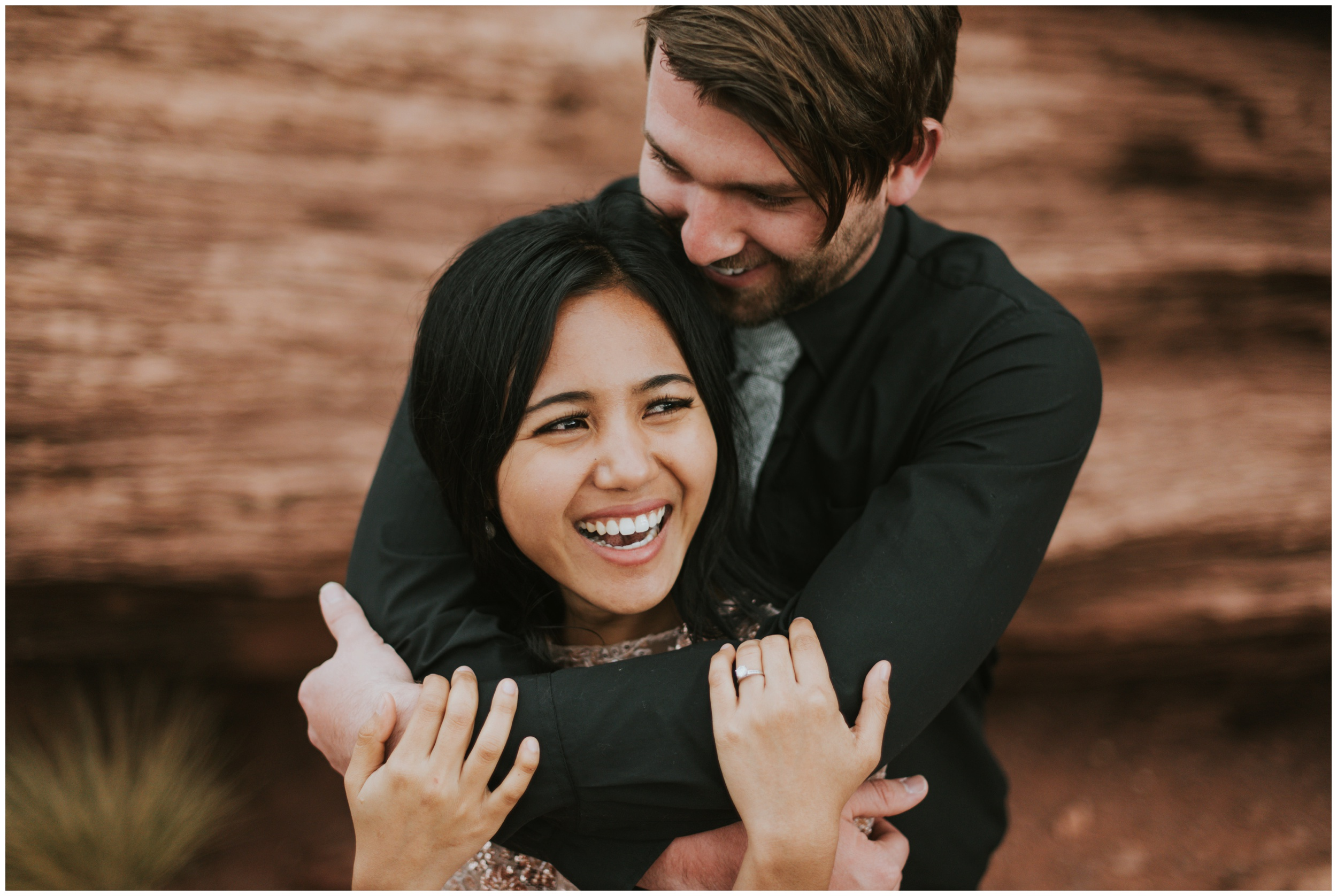 Close up photo of beautiful bride smiling with her groom wrapped around her | Elopement Photographer www.riversandroadsphotography.com