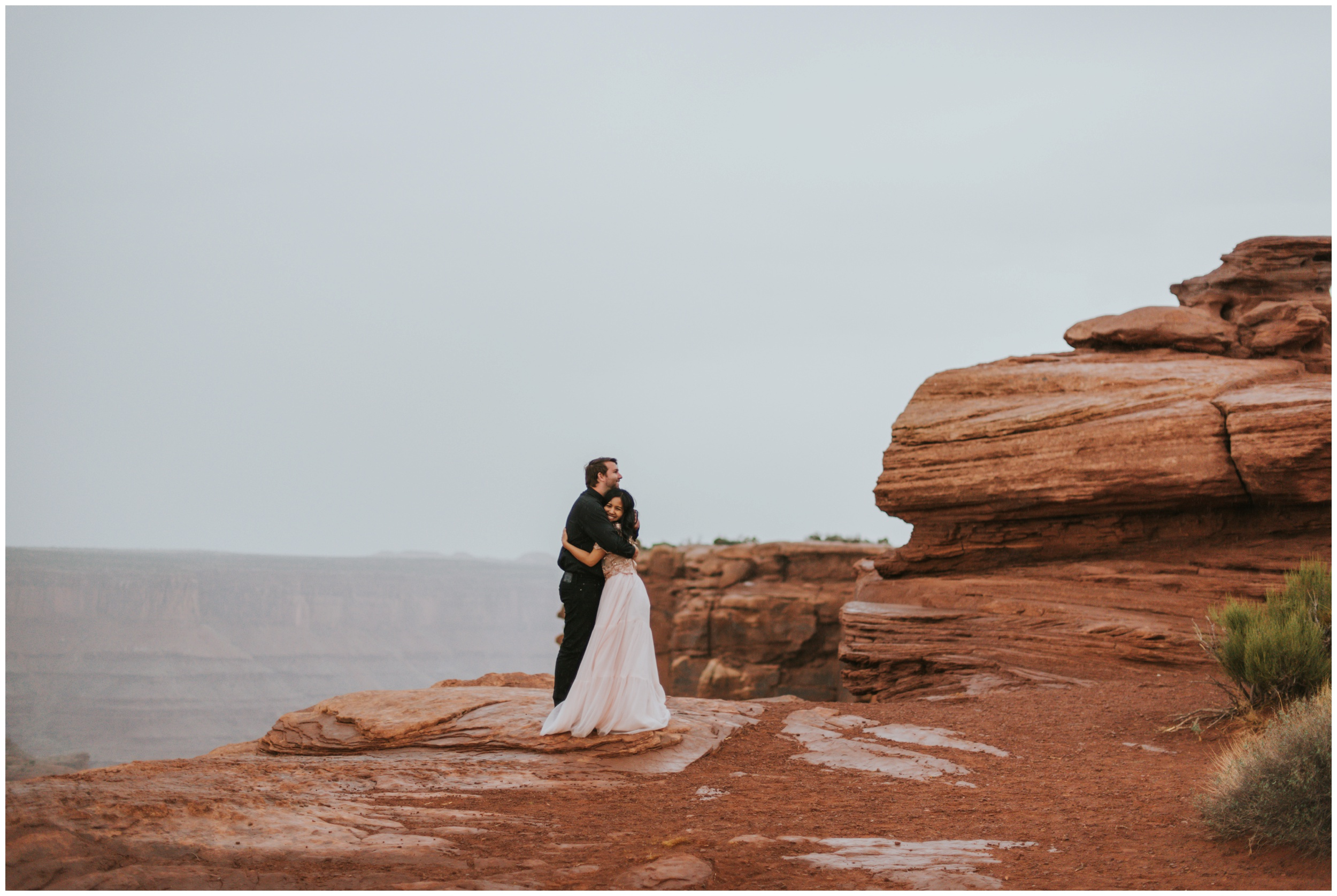 couple hugging and laughing after dancing with each other | Elopement Photographer www.riversandroadsphotography.com