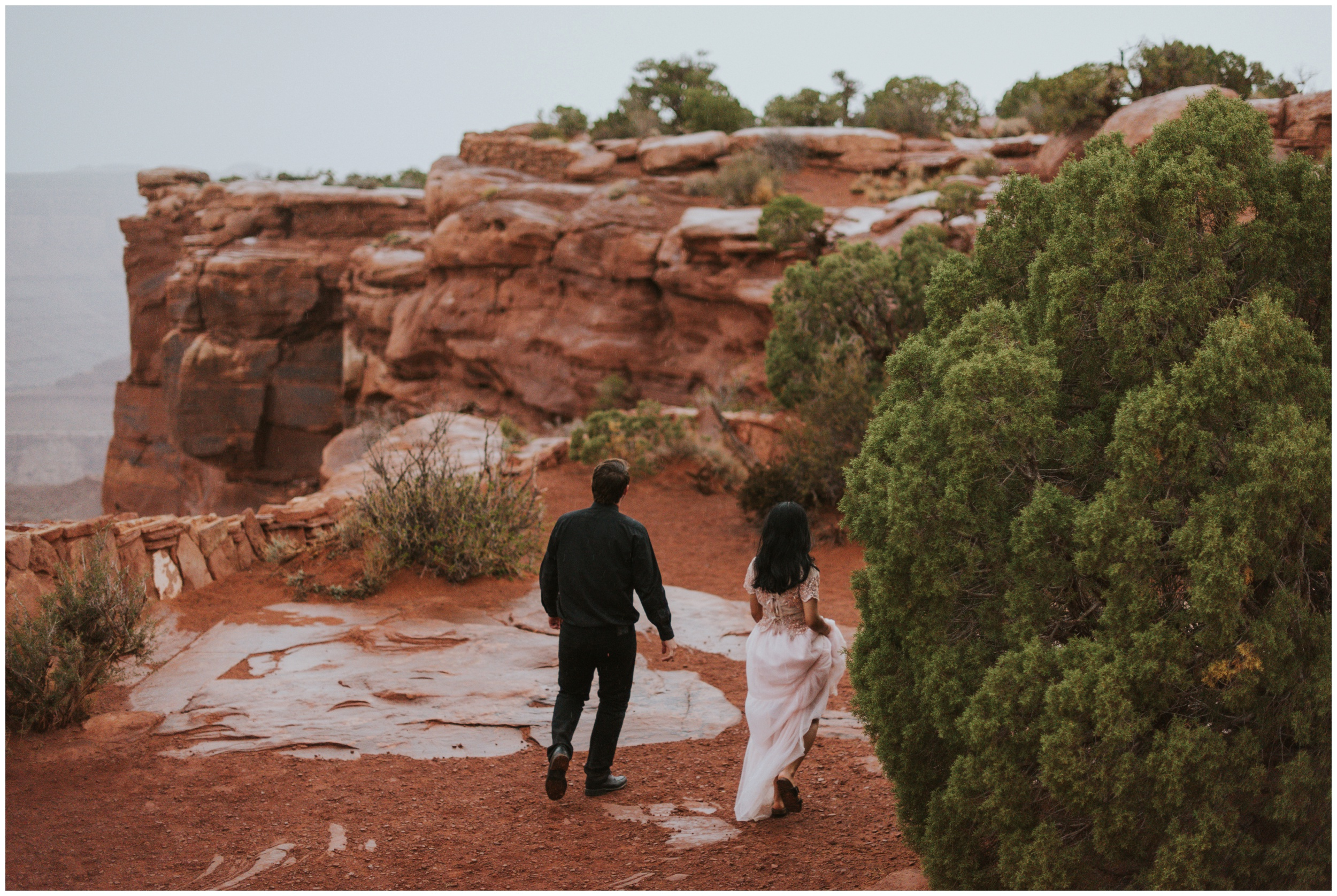 bride and groom walking in the rain together wedding day | Elopement Photographer www.riversandroadsphotography.com
