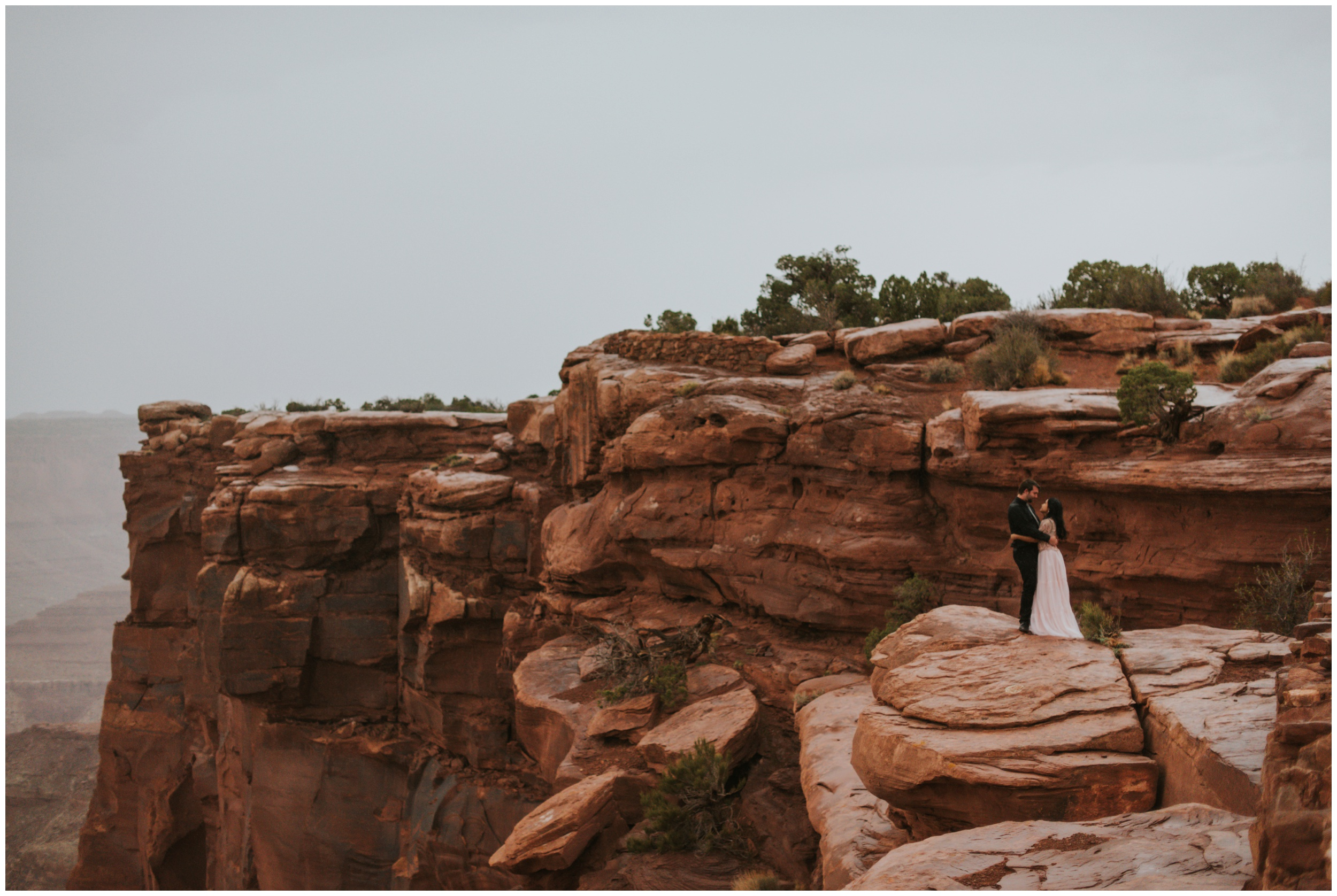 beautiful landscape portrait of couple at dead horse point state park overlook | Elopement Photographer www.riversandroadsphotography.com