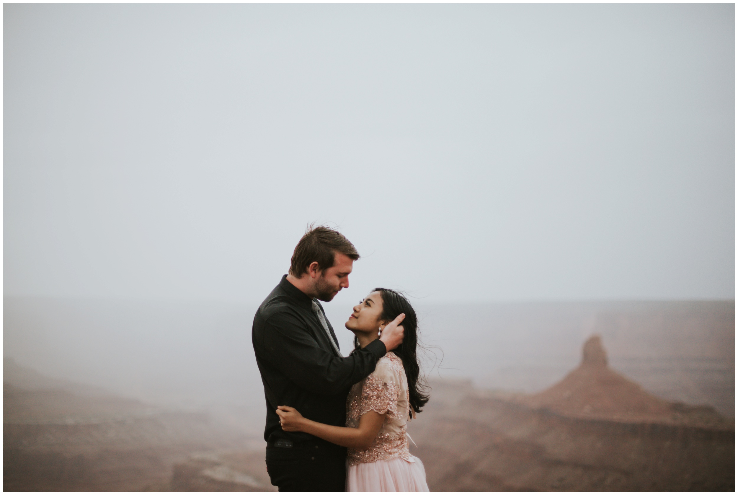 couple getting ready to kiss, looking at each other sweetly hand in hair | Elopement Photographer www.riversandroadsphotography.com